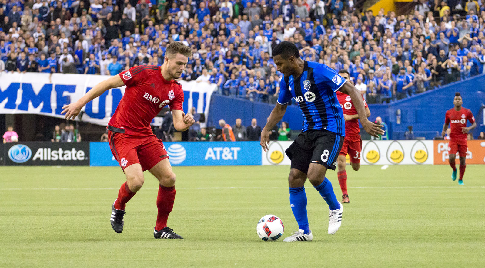 The reds try to hold off Montreal's offensive pressure during the first half. Image by Dennis Marciniak of denMAR Media.