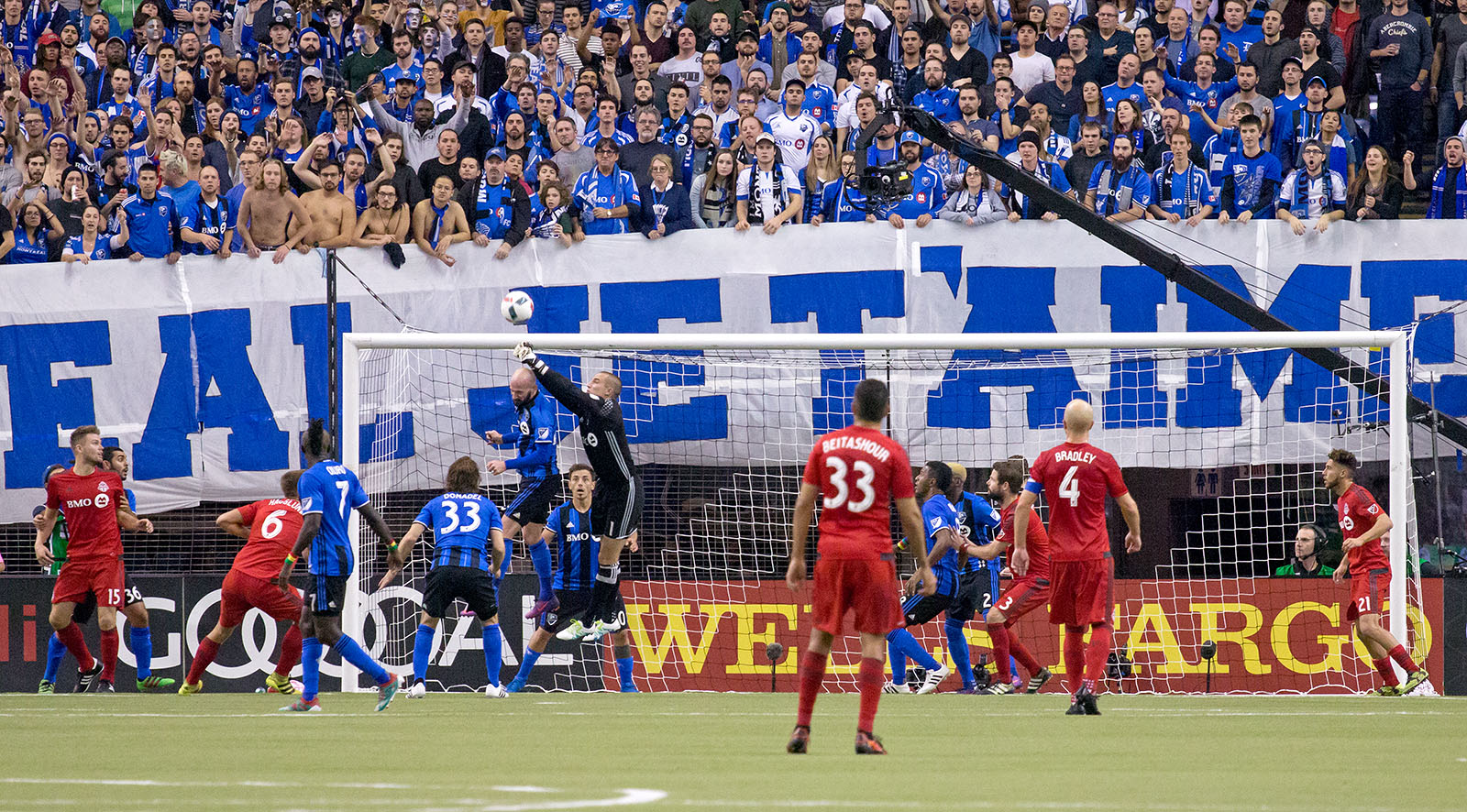 Montreal supporters look on as Montreal Goalkeeper Evan Bush punches the ball out of the 6 yard box during an Eastern Conference Final match in 2016. Image by Dennis Marciniak of denMAR Media.