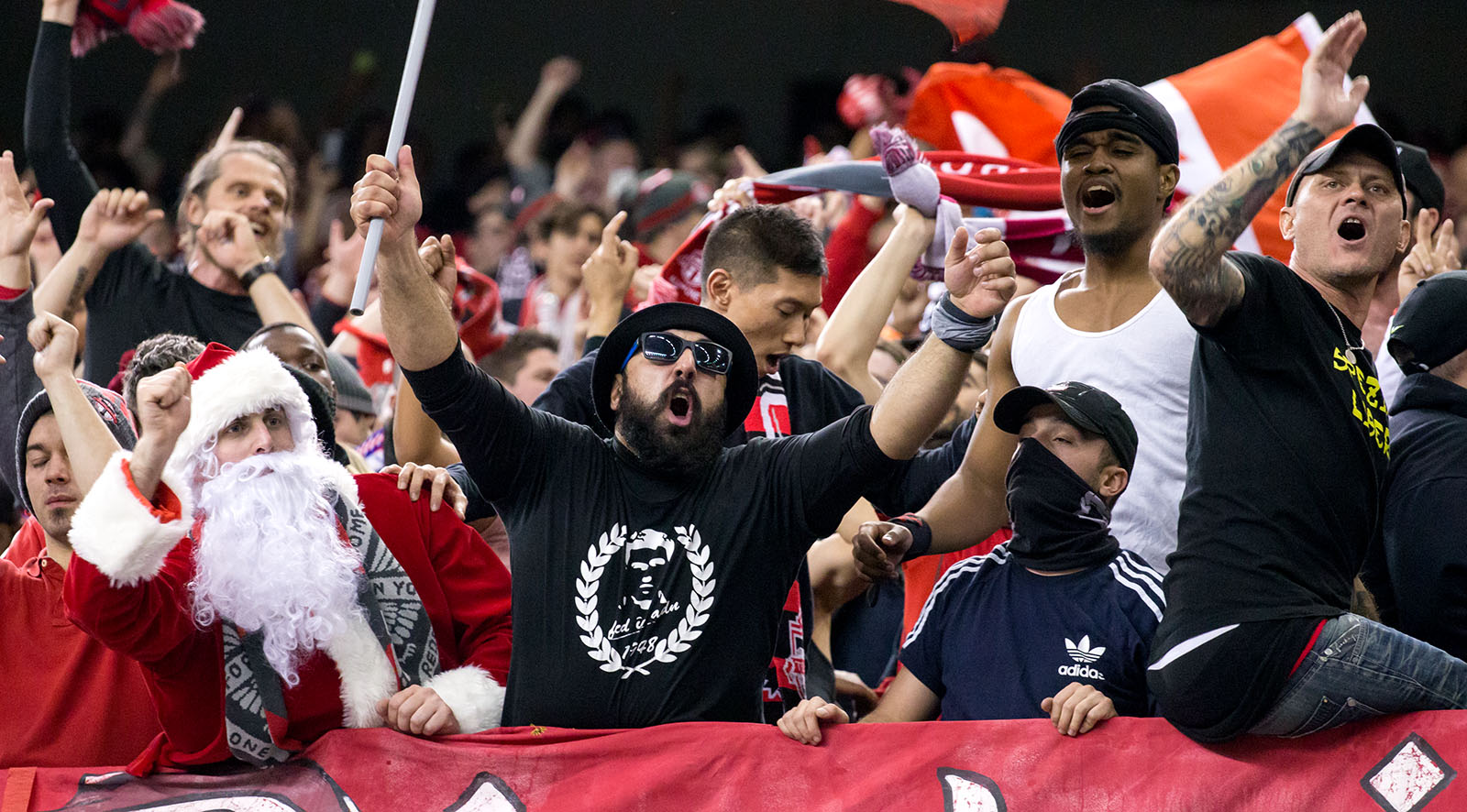 Toronto FC supporters celebrate a goal after being down 3-0 during the first leg of the eastern conference final on November 22, 2016.