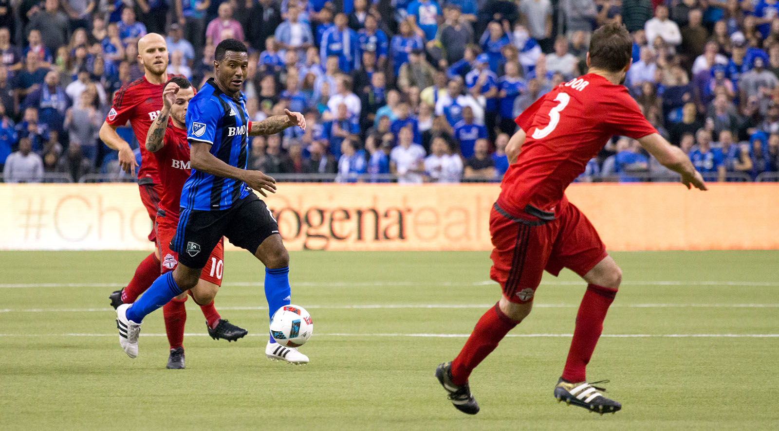 Giovinco and Bradley try to grab the ball back from a Montreal midfielder.