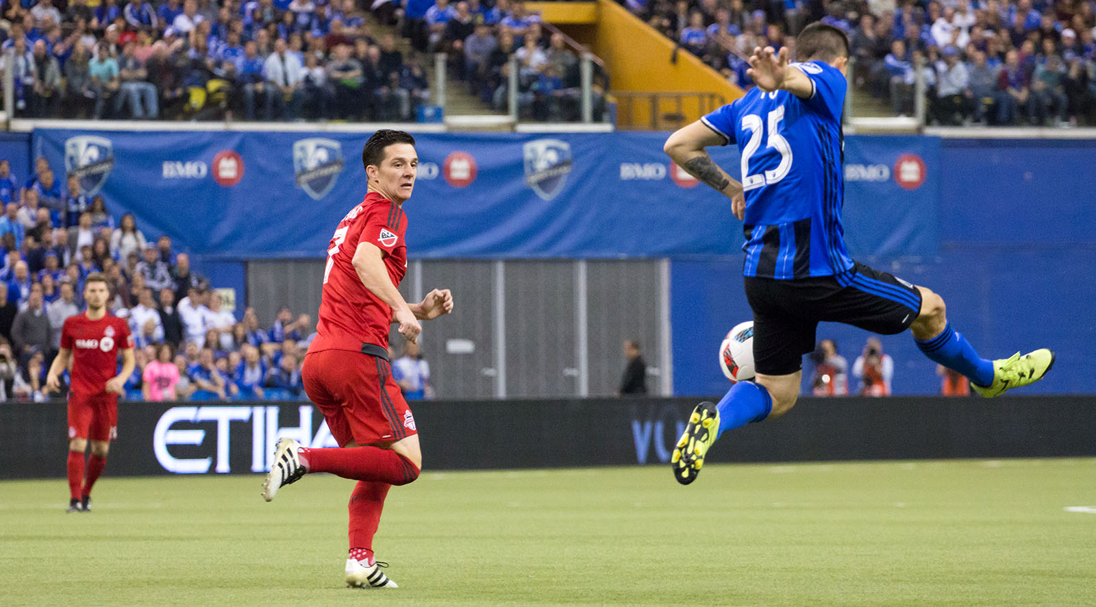Will Johnson looking to keep tight space on the opposition during a MLS Cup Playoff Game in Montreal in 2016. Image by Dennis Marciniak of denMAR Media.