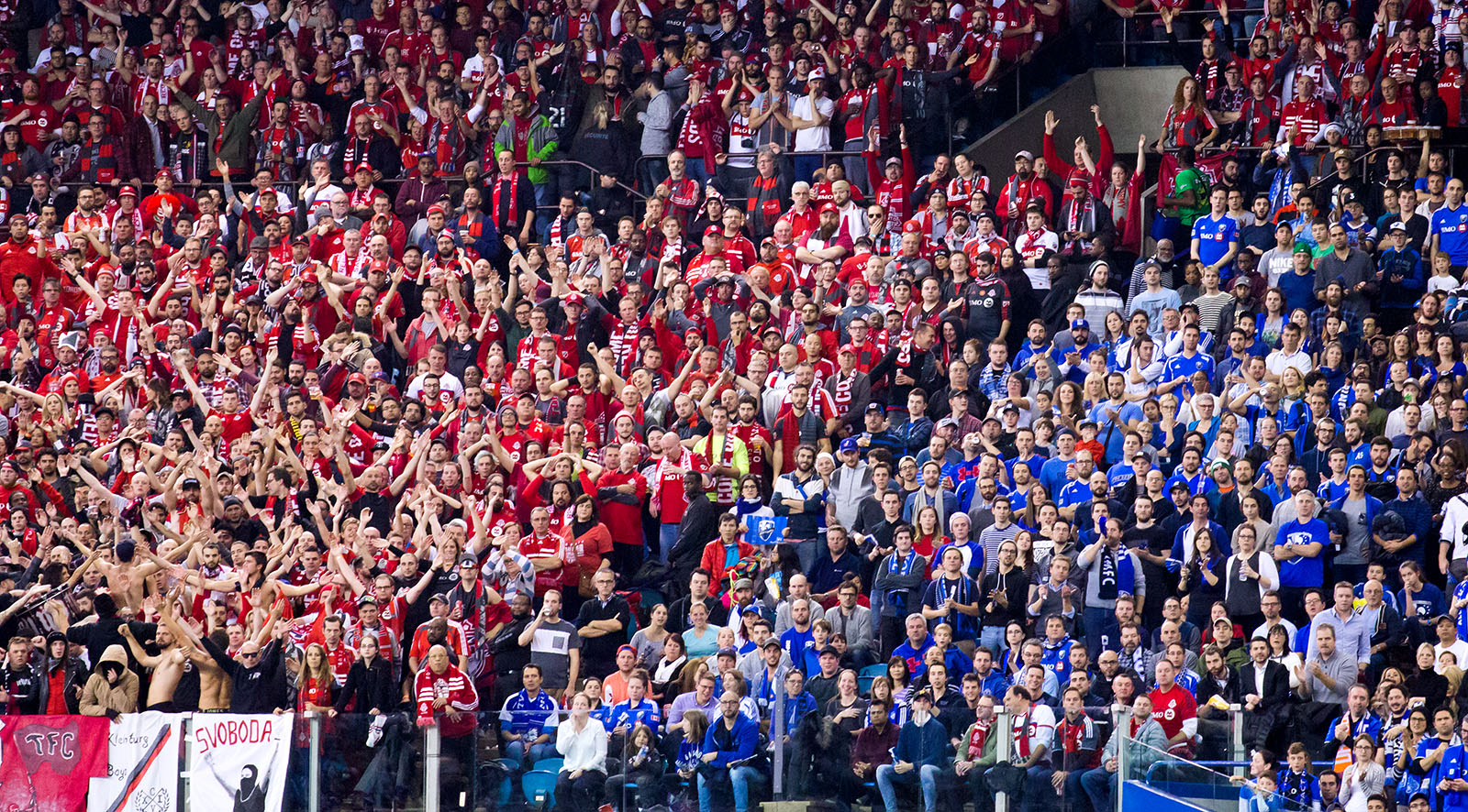 The line in the stands that divides Toronto FC supporters from Montreal Impact fans during the first ever Canadian Eastern Conference Final match in Montreal. Image by Dennis Marciniak of denMAR Media.