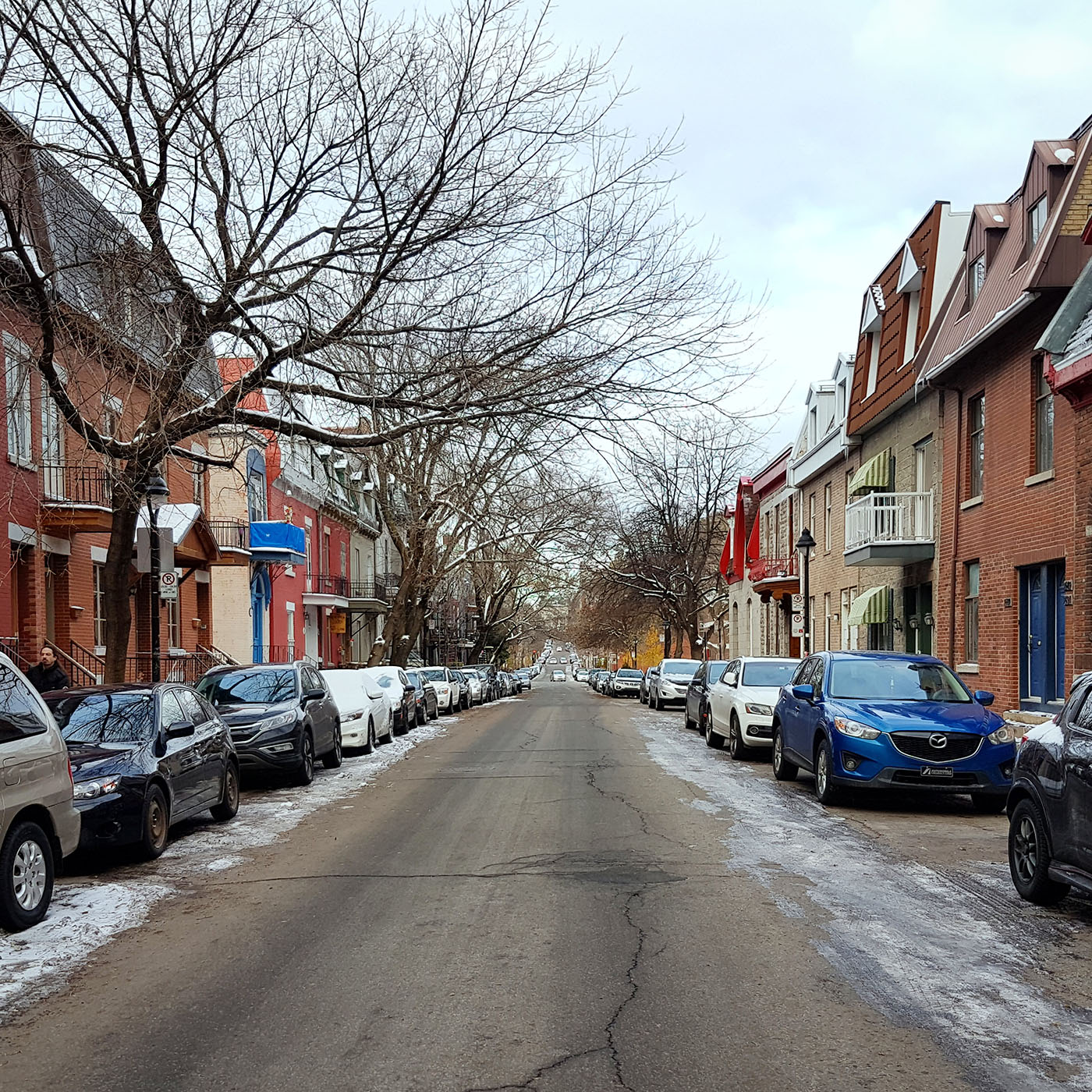 Looking down Rue Saint-André in Montreal, Quebec on a cold winter day. Image by Dennis Marciniak of denMAR Media.