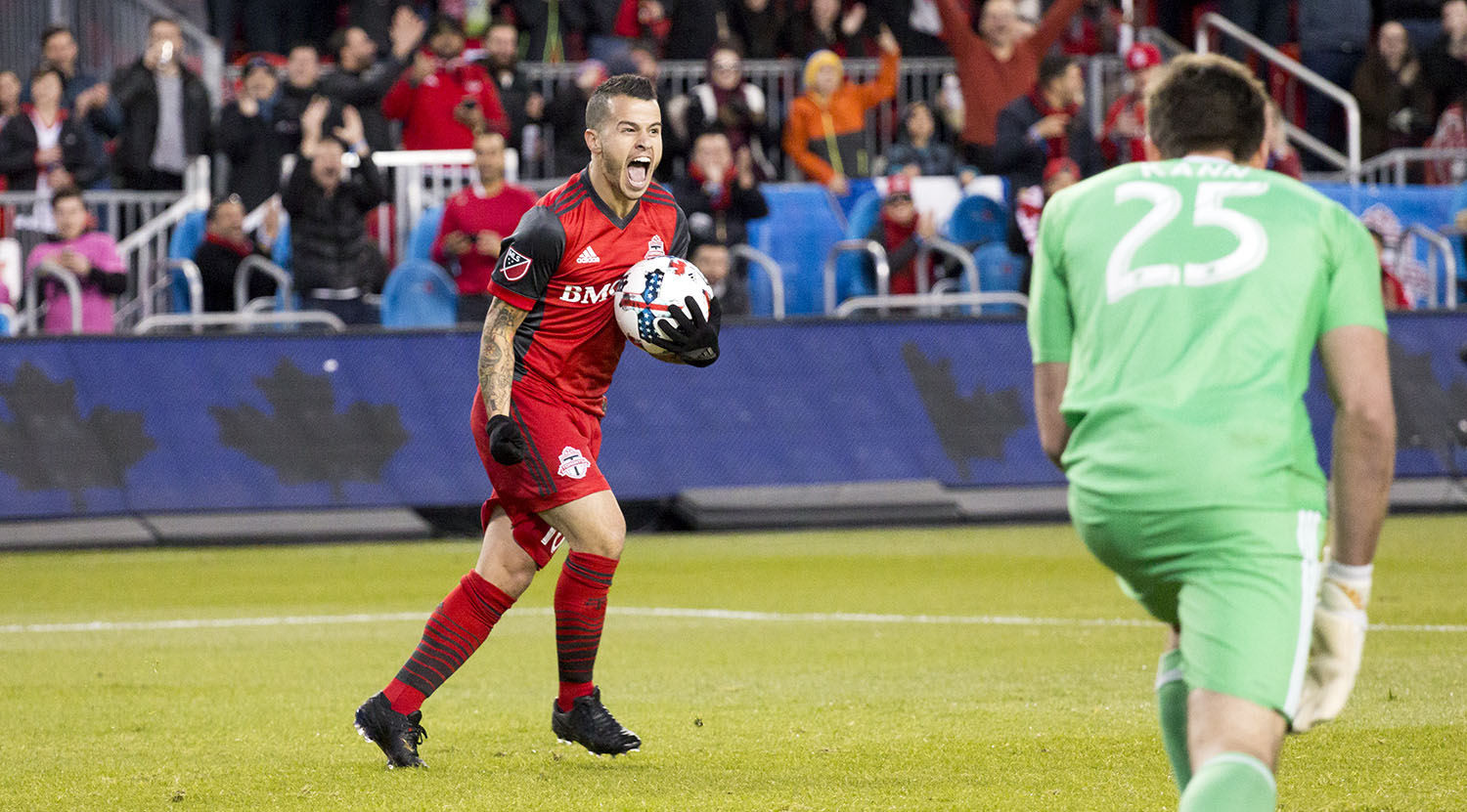 Sebastian Giovinco celebrating a goal with the ball in hand during a Major League Soccer game against Atlanta United FC. Image by Dennis Marciniak of denMAR Media.