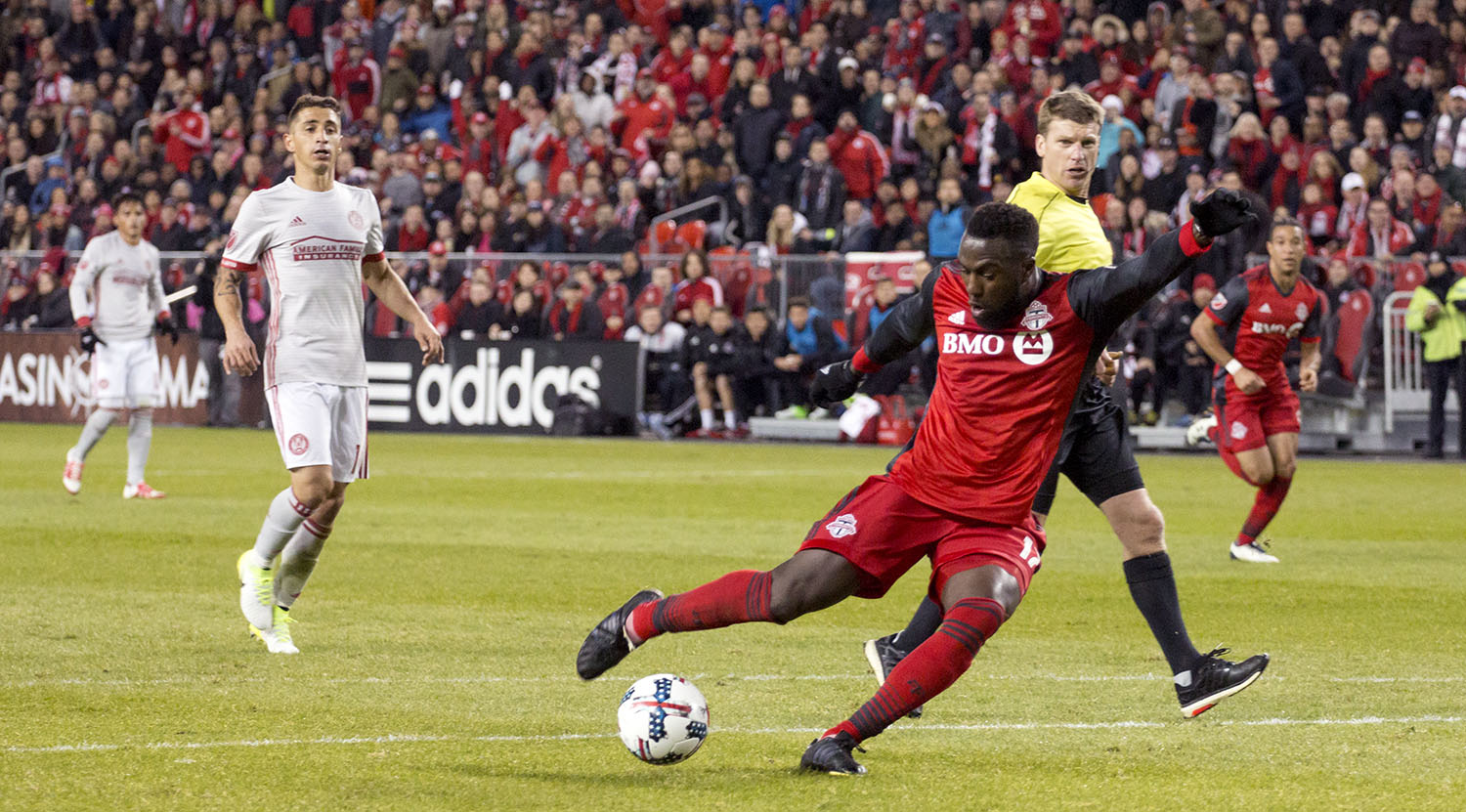 Jozy Altidore strieks the ball on goal against Atlanta United FC in a MLS regular season game at BMO Field. Image by Dennis Marciniak of denMAR Media.