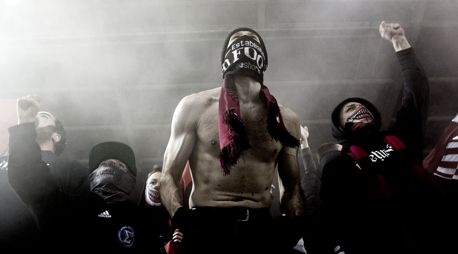 A shirtless south end supporter in the smoke during a Major League Soccer game against Atalnta United FC. Image by Dennis Marciniak of denMAR Photography.
