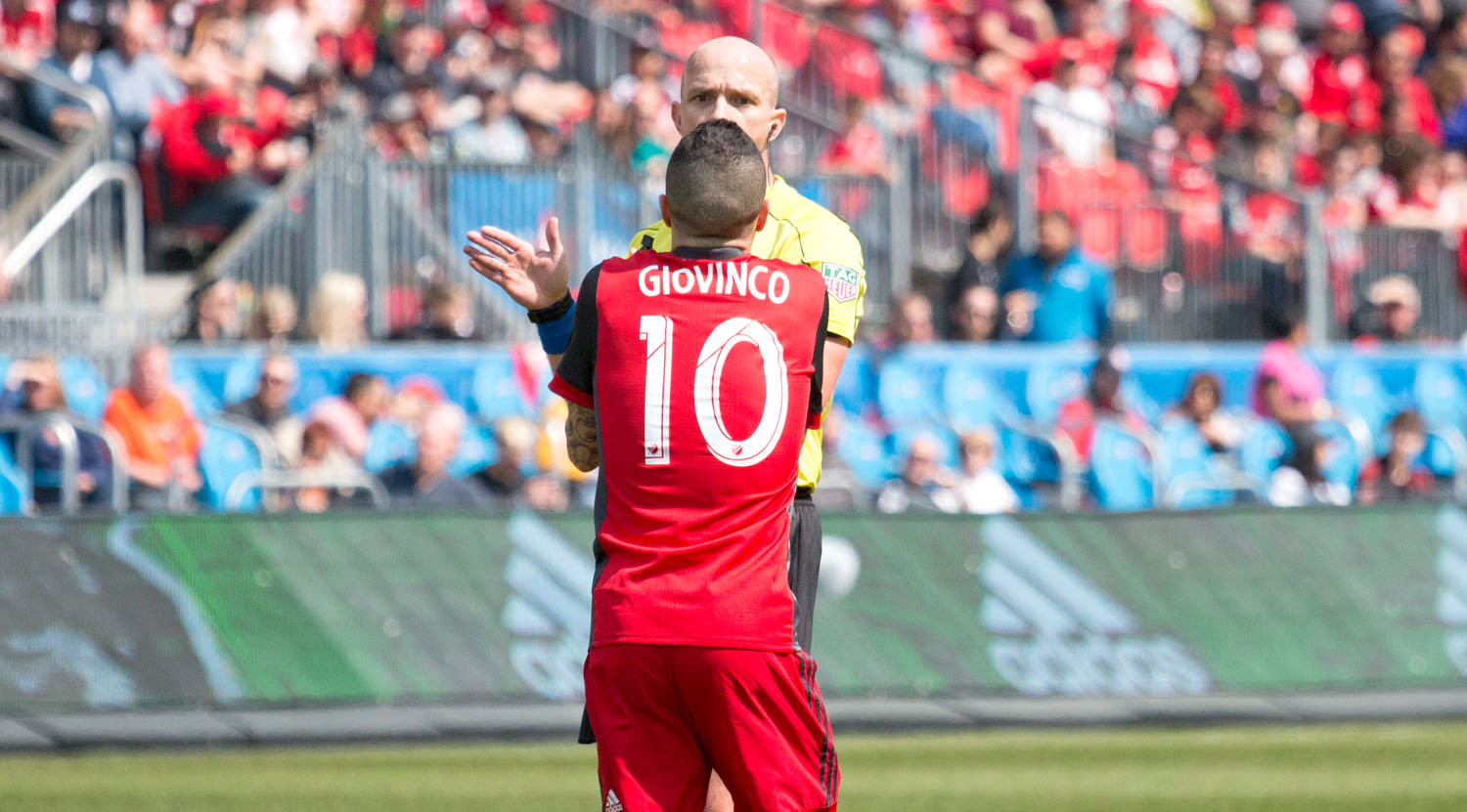 Sebastian Giovinco exchanging words with first official Allan Chapman over a call in the box.Image by Dennis Marciniak of denMAR Media.