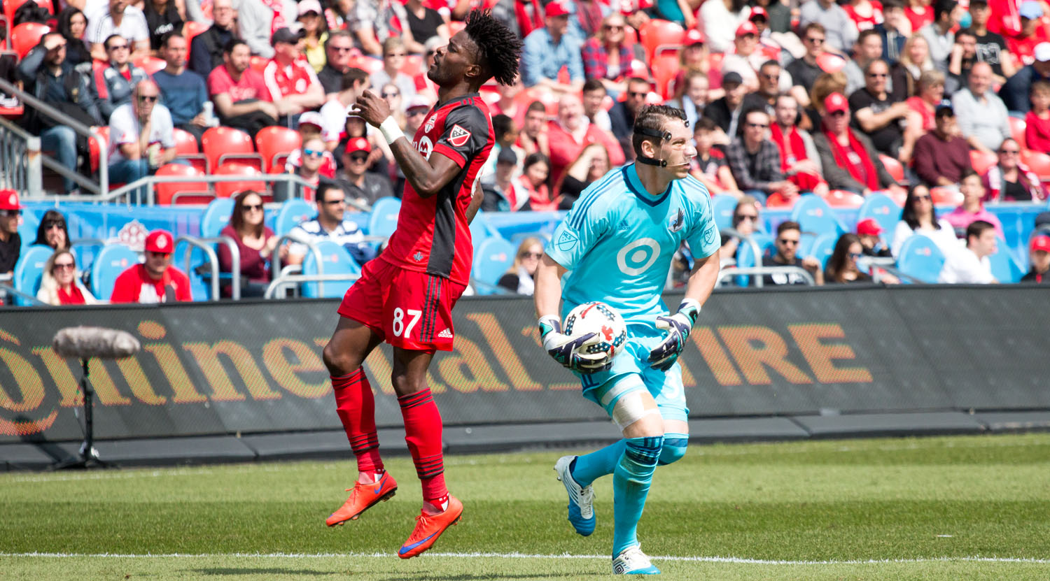 Tosaint Ricketts just missed uot on a ball that was snagged by Bobby Shuttleworth who was wearing a face mask for the duration of the match.Image by Dennis Marciniak of denMAR Media.