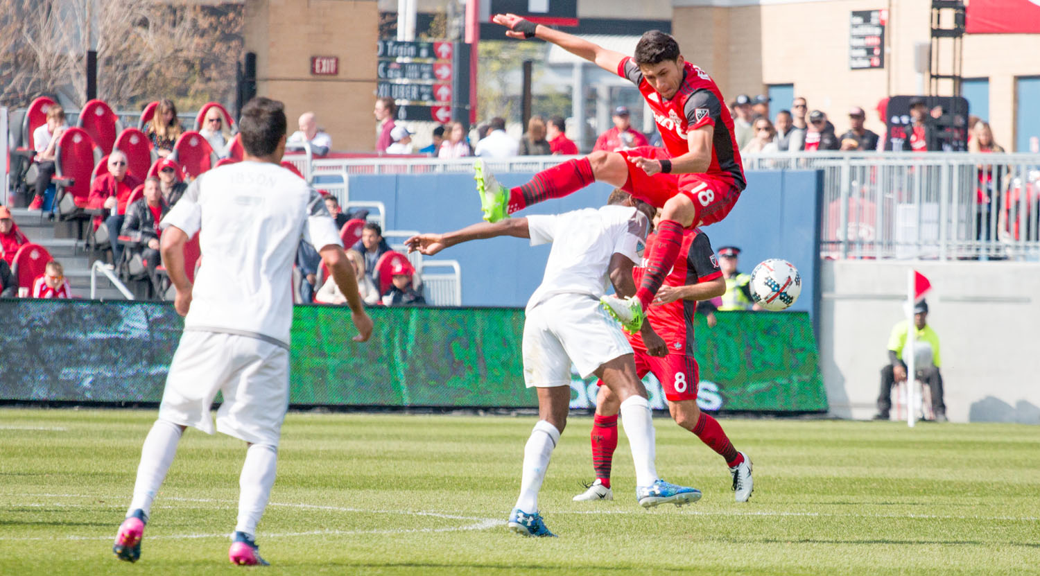 Marky Delgado on his way down to the ground from a challenge by a Minnesota United FC player.Image by Dennis Marciniak of denMAR Media.