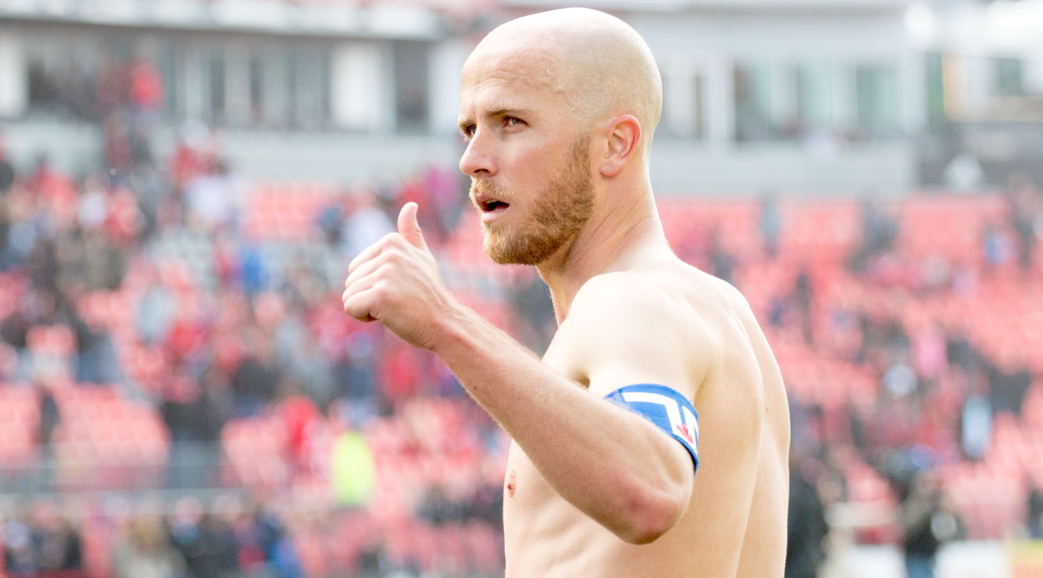 Michael Bradley giving the thumbs up to fans with the Toronto Flag captain armband after a beautiful 3-2 win over Minnesota United FC. Image by Dennis Marciniak of denMAR Media.