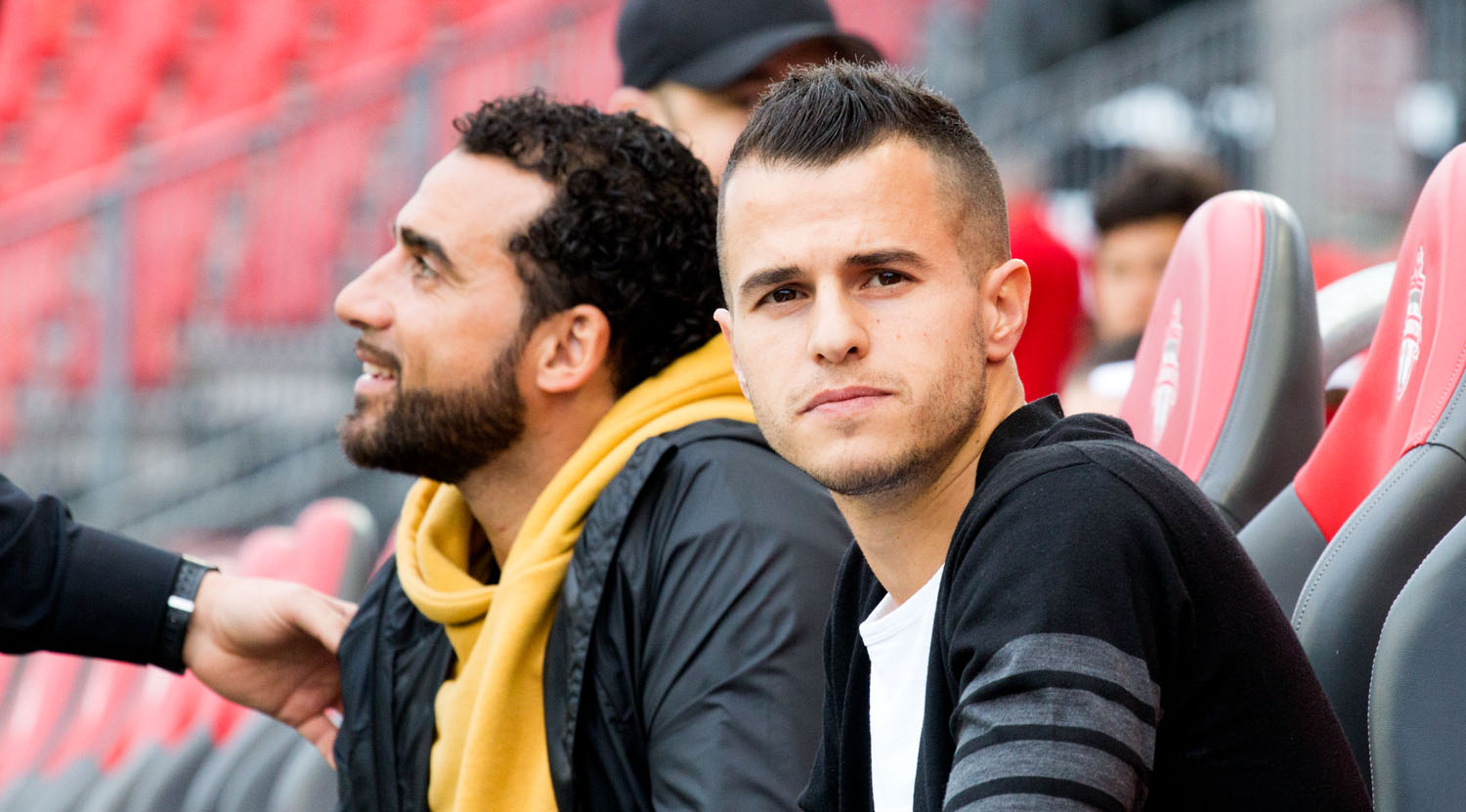 Two Toronto FC legends Dwayne De Rosario and Sebastian Giovinco watching the pregame warm ups from the bench. Image by Dennis Marciniak of denMAR Media.