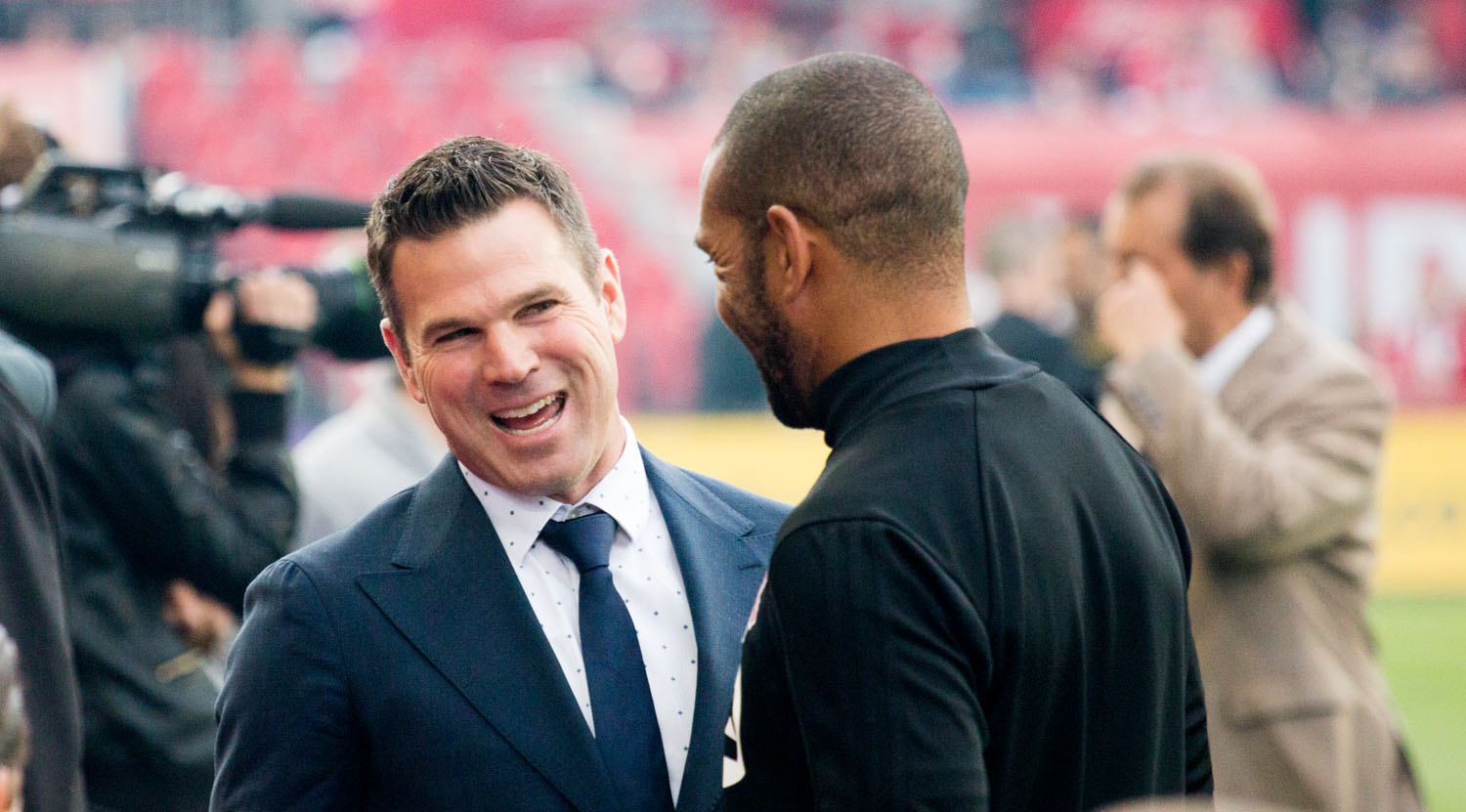 Greg Vanney having a discussion with Toronto FC coaching staff during the pregame warm ups at BMO FIeld. Image by Dennis Marciniak of denMAR Media.