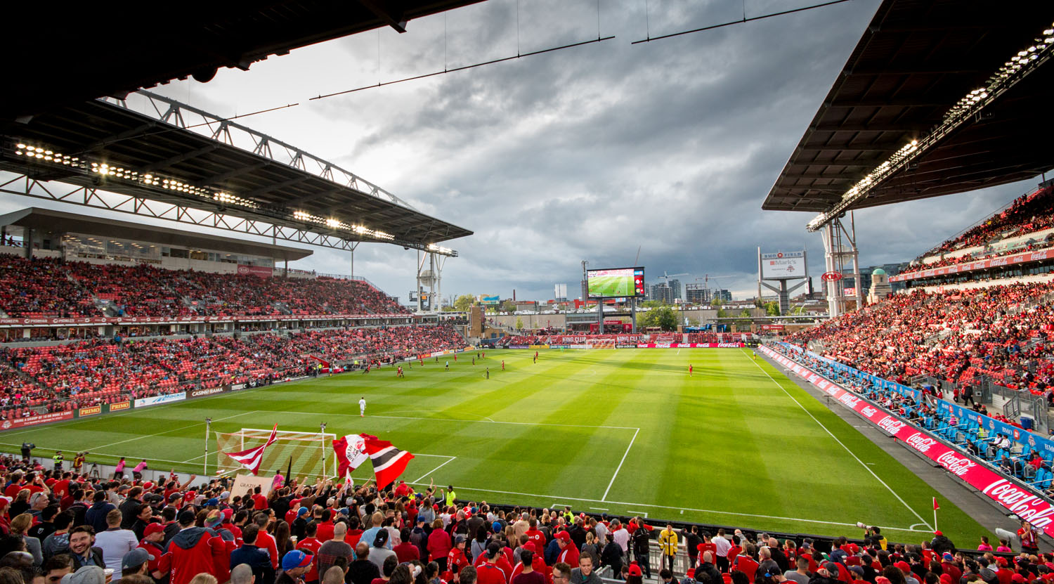 The sun peaking through the rain clouds at BMO Field on a warm spring night in May 2017. Image by Dennis Marciniak of denMAR Media.