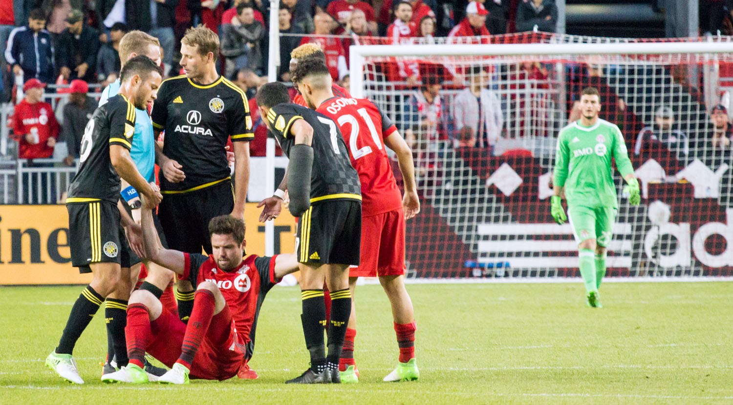 FIFA Fair Play in full effect at Columbus Crew players help up from the field.