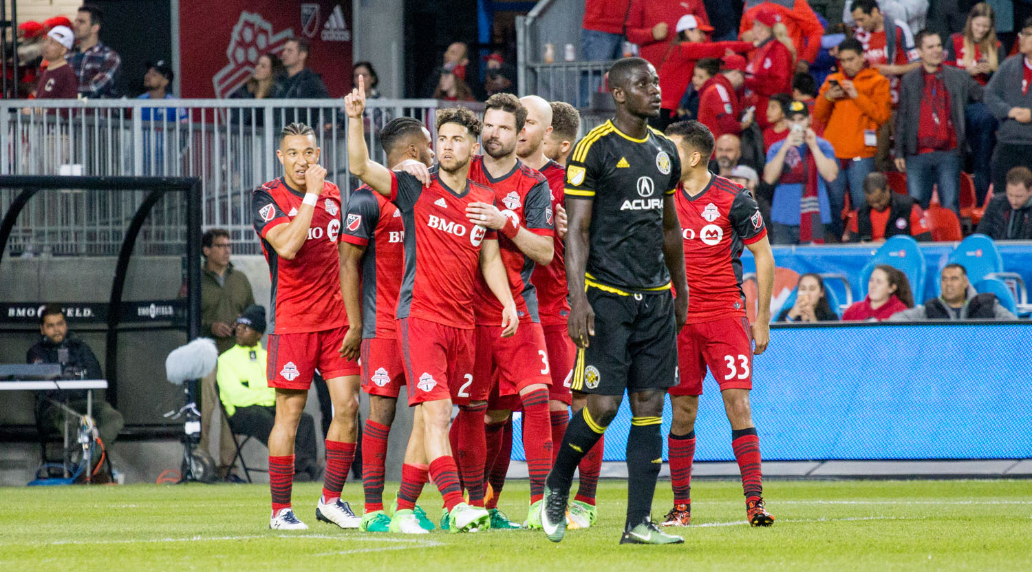 Jonathan Osorio celebrates with the rest of the Toronto FC squad on a Trillium Cup match final. Image by Dennis Marciniak of denMAR Media.