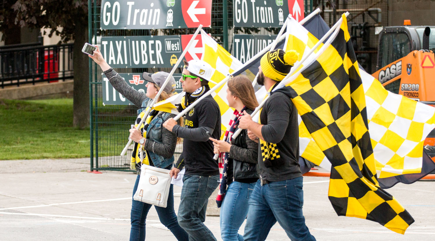 Visiting Columbus Crew SC fans outside of BMO Field in Toronto taking a selfie before a Major League Soccer match. Image by Dennis Marciniak of denMAR Media.