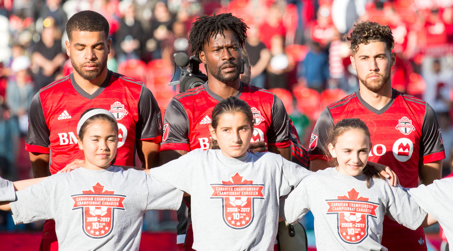 Jordan Hamilton,Tosaint Ricketts, and Jonathan Osorio line up for the Canadian National Anthem during a Canadian Championship game in 2017.Jonathan Osorio.Image by Dennis Marciniak of denMAR Media.