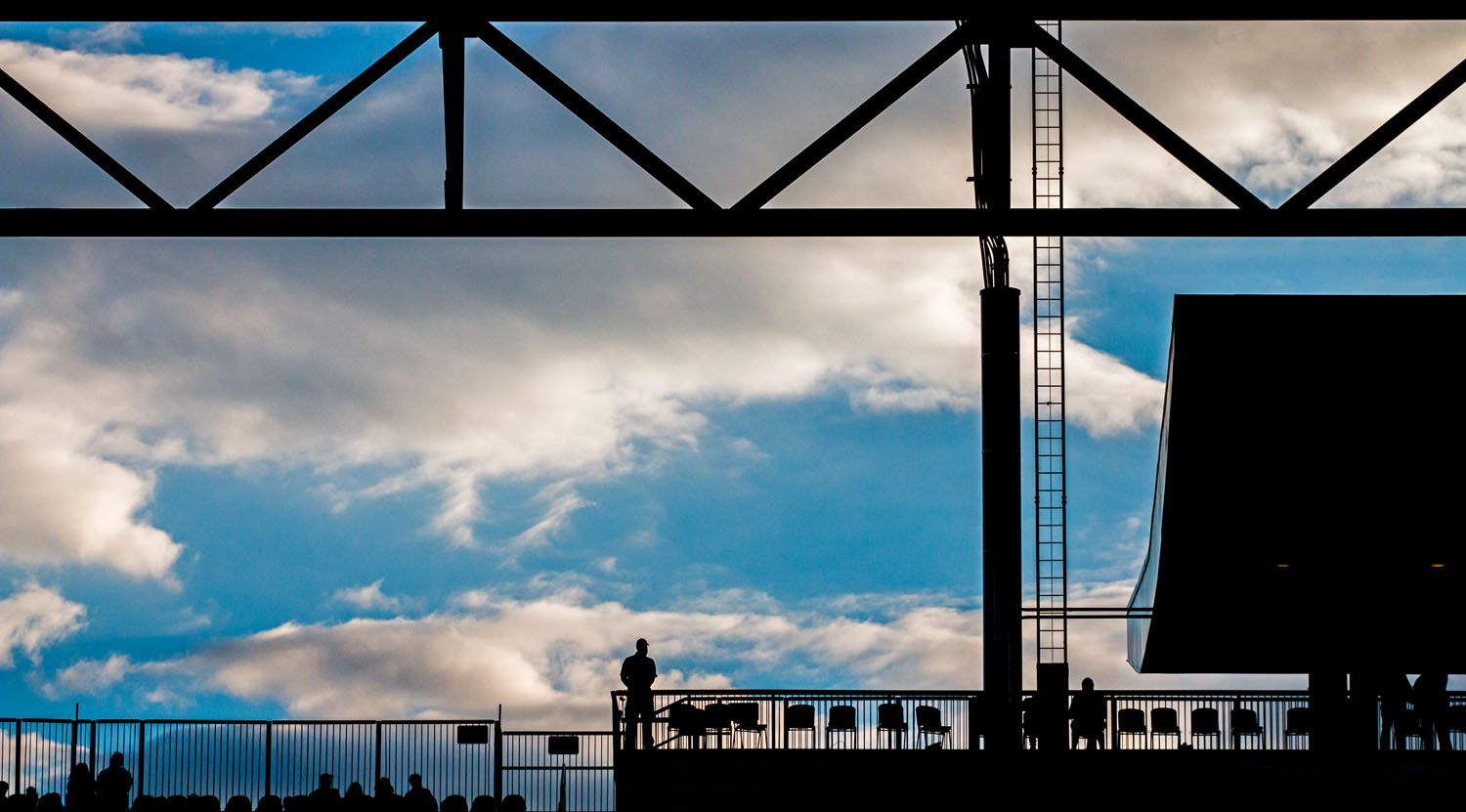 Security at the top of the stadium backlit watching over the game during the 2017 Canadian CHampionship at BMO Field.Image by Dennis Marciniak of denMAR Media.