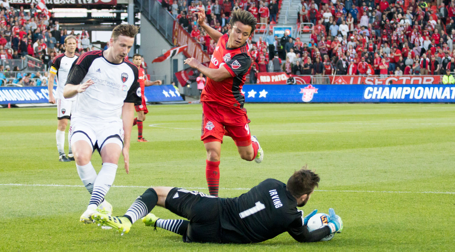 Tsubasa Endoh gets edged out by Ottawa Fury goalkeeper Callum Irving during the Canadian Championship in 2017.