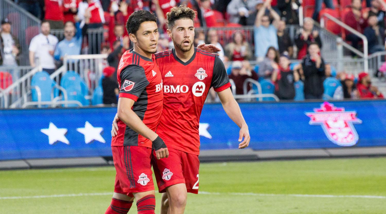 Marco Delgado and Tsubasa Endoh celebrate another Toronto FC goal.Image by Dennis Marciniak of denMAR Media.