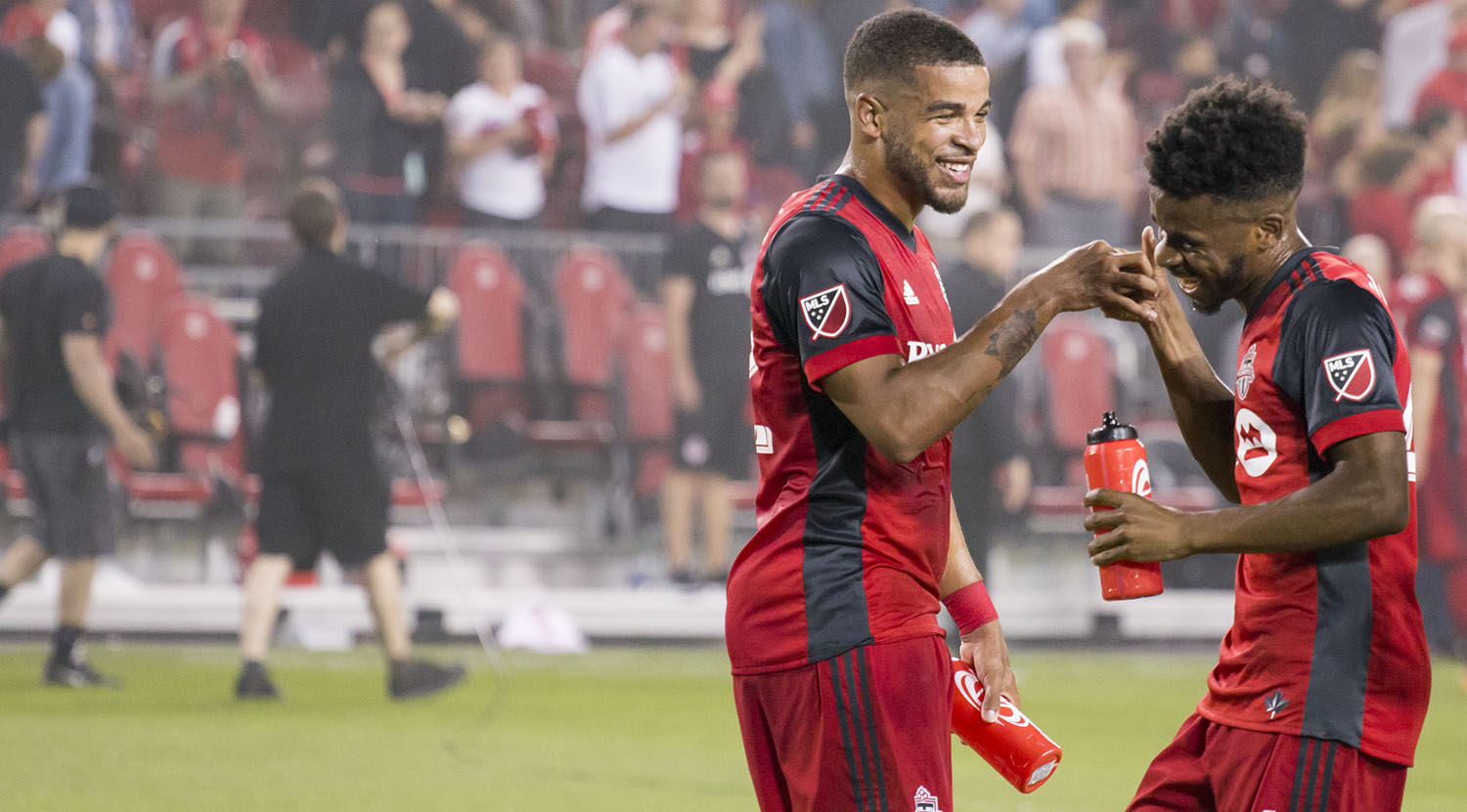 Jordan Hamilton and Raheem Edwards do a little finger thing in celebration of a 2-0 win over DC United. Image by Dennis Marciniak of denMAR Media.