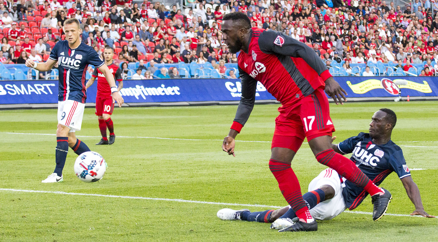 Jozy Altidore gets the ball poked away from him. Image by Dennis Marciniak of denMAR