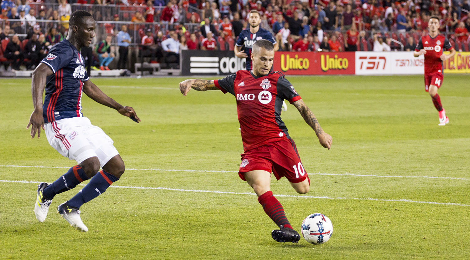 Sebastian Giovinco shoots a ball from inside the 18 yard box to bring Toronto FC to 2-0 on the night against New England Revolutin. Image by Dennis Marciniak of denMAR Media.