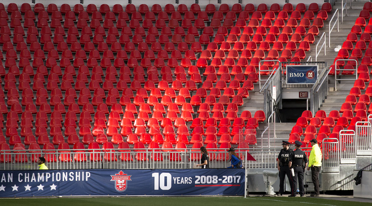 Toronto Police officers watch over the empty stands as staff get the field ready for the Canadian Championship.Image by Dennis Marciniak of denMAR Media.