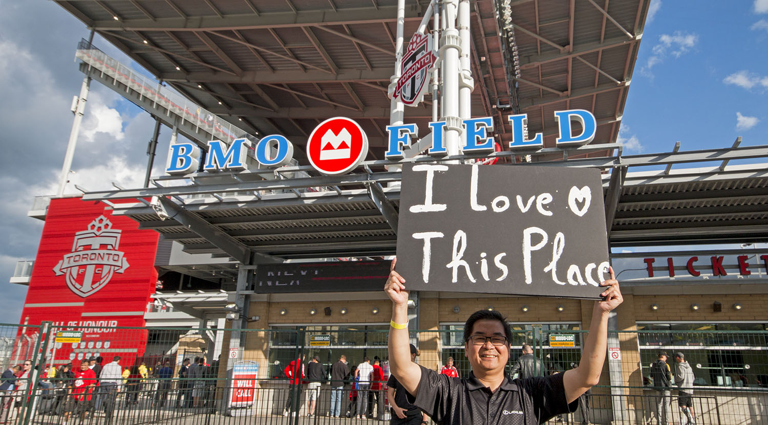 Does anyone know who this is? The week before he had a sign saying that it was his first game and now he has a sign that says, 'I love this place'.Image by Dennis Marciniak of denMAR Media.