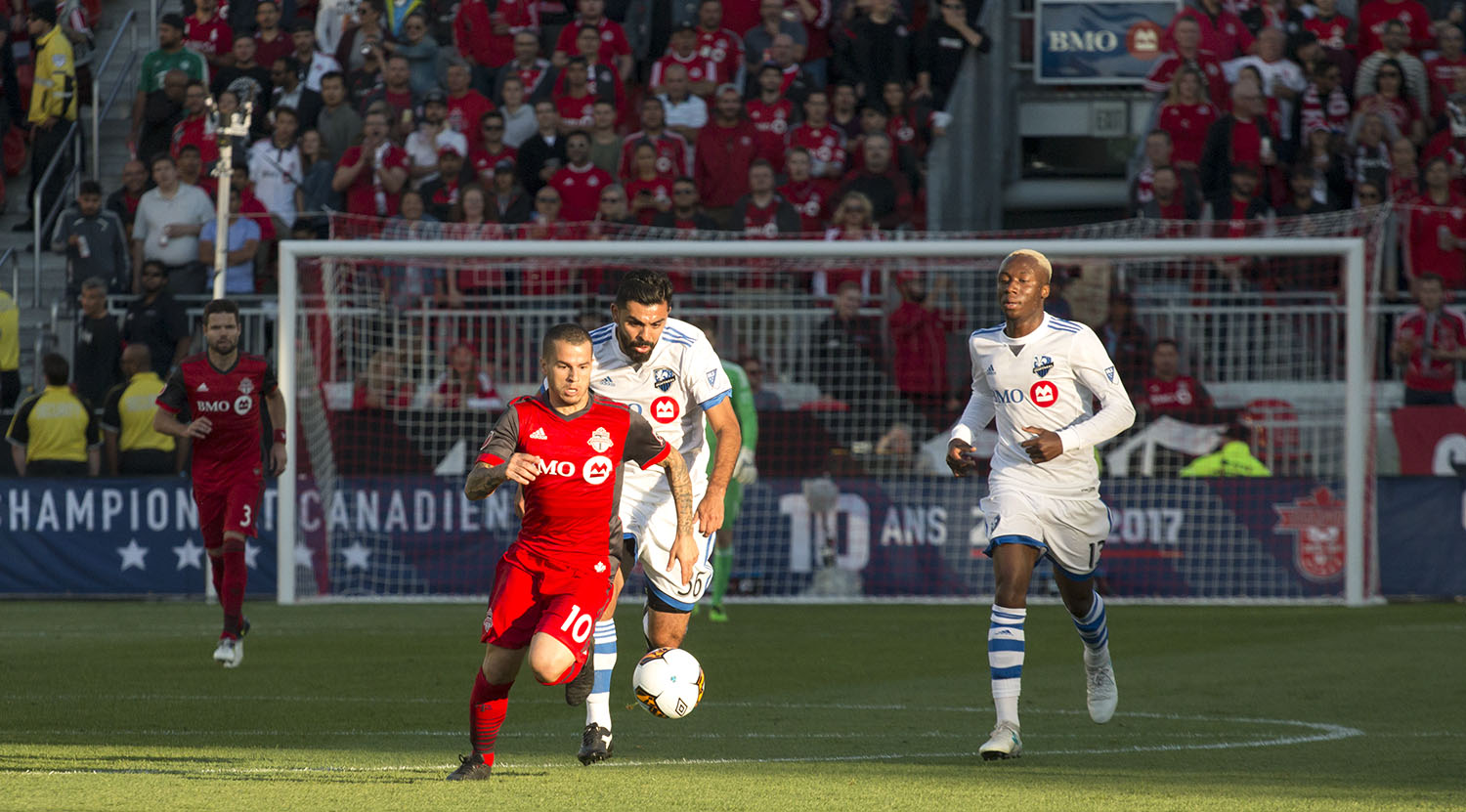 Sebastian Giovinco flies past the Montreal Impact defenders during a game in 2017.Image by Dennis Marciniak of denMAR Media.