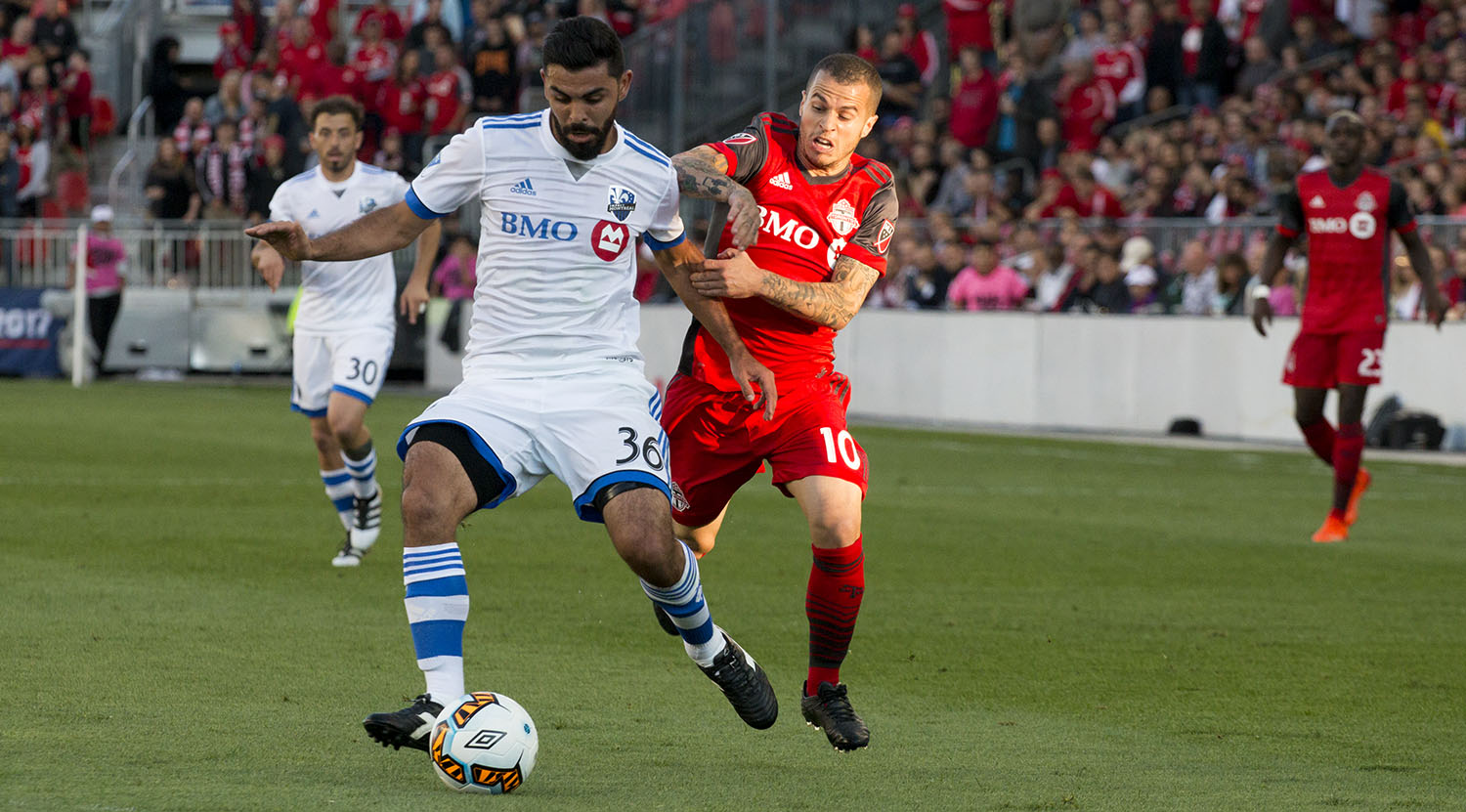 Victor Cabrera tries to get the ball away from Sebastian Giovinco during the Canadian Championship finale in 2017.Image by Dennis Marciniak of denMAR Media.