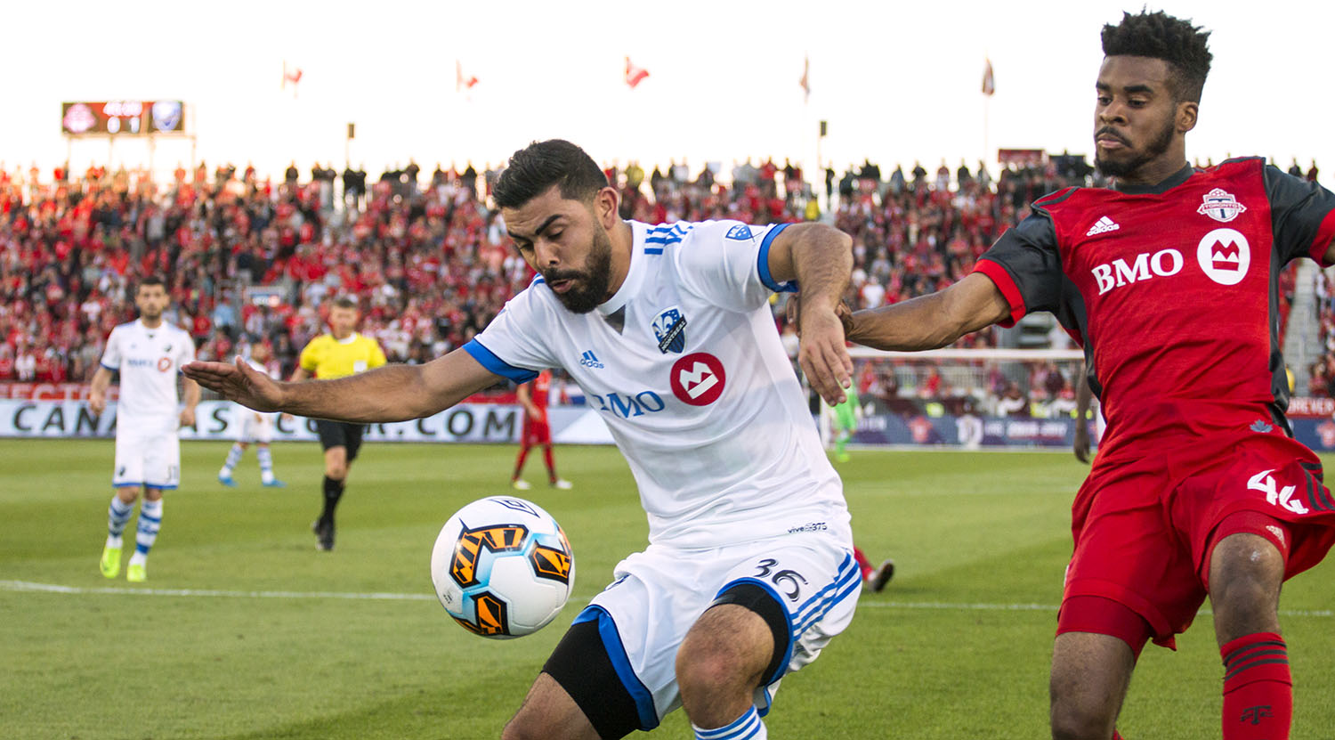 Raheem Edwards and Victor Cabrera go for the ball as the sun sets at BMO FIeld in 2017.Image by Dennis Marciniak of denMAR Media.