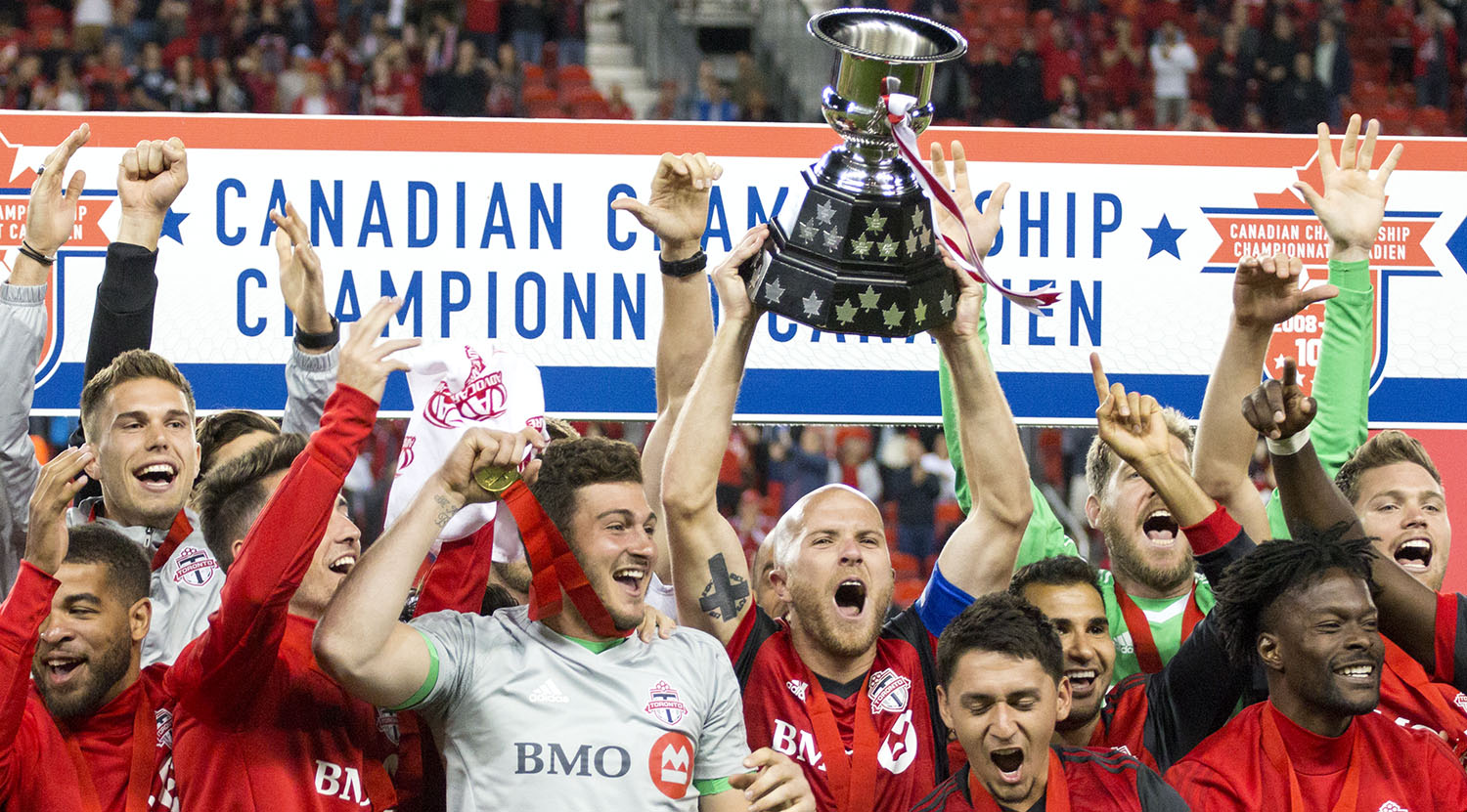 Toronto FC celebrate winning the 2017 Canadian Championship by hoisting the Voyageurs Cup in 2017 at BMO Field. Good job boys!Image by Dennis Marciniak of denMAR Media.