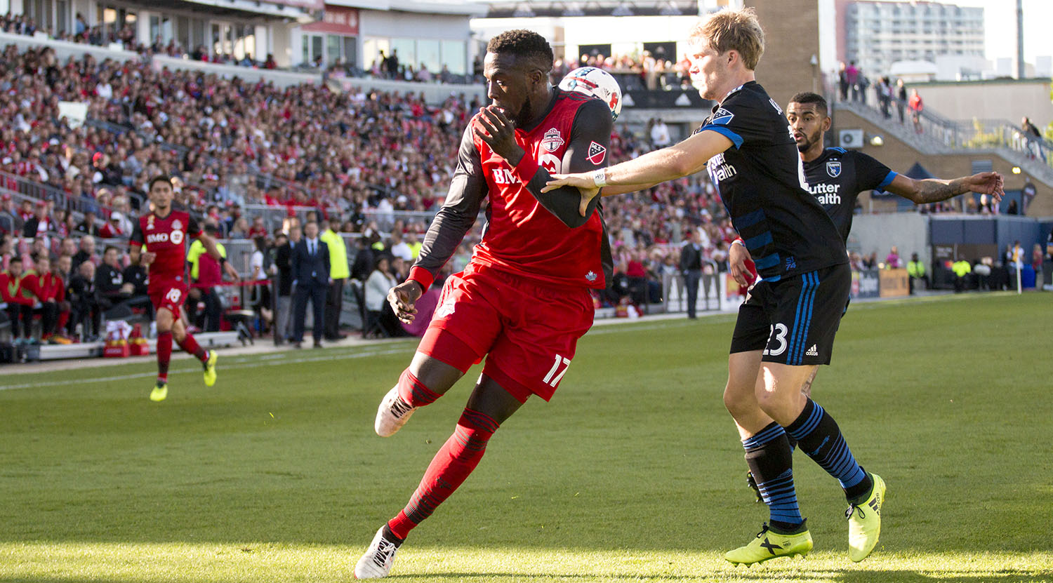 Jozy Altidore flicks the ball behind is back to get an advantage on a defender at BMO Field of a MLS Regular Season match. Image by Dennis Marciniak of denMAR Media.