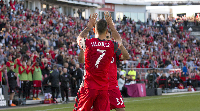 Víctor Vázquez celebrates with Steven Betiashour for the first goal on the day against San Jose. Image by Dennis Marciniak of denMAR Media.