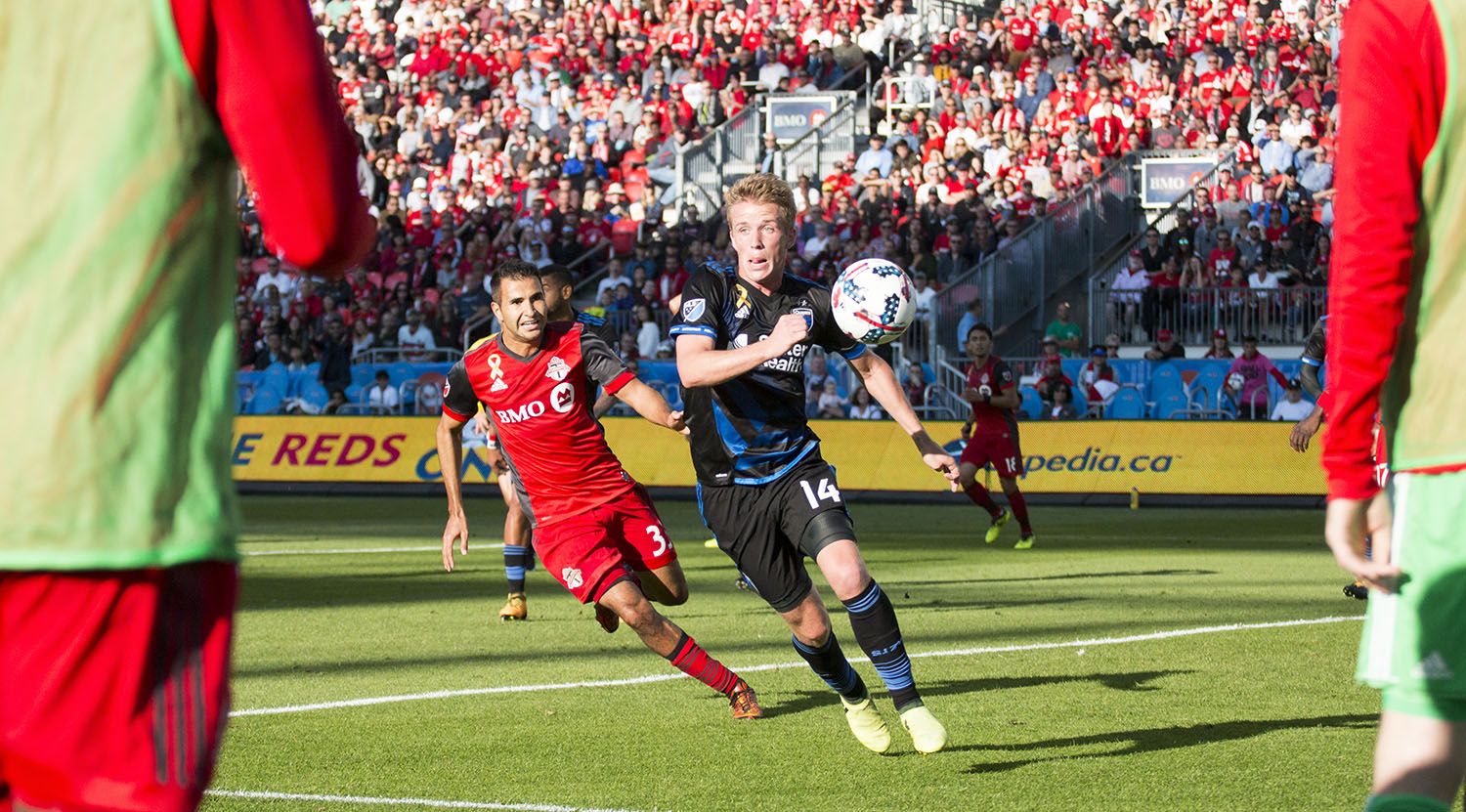 Steven Betiashour trying to get the ball from a defender shot between Toronto FC subsitutues.