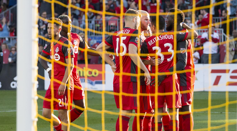 Toronto FC celebrates a goal. Image by Dennis Marciniak of denMAR Media.