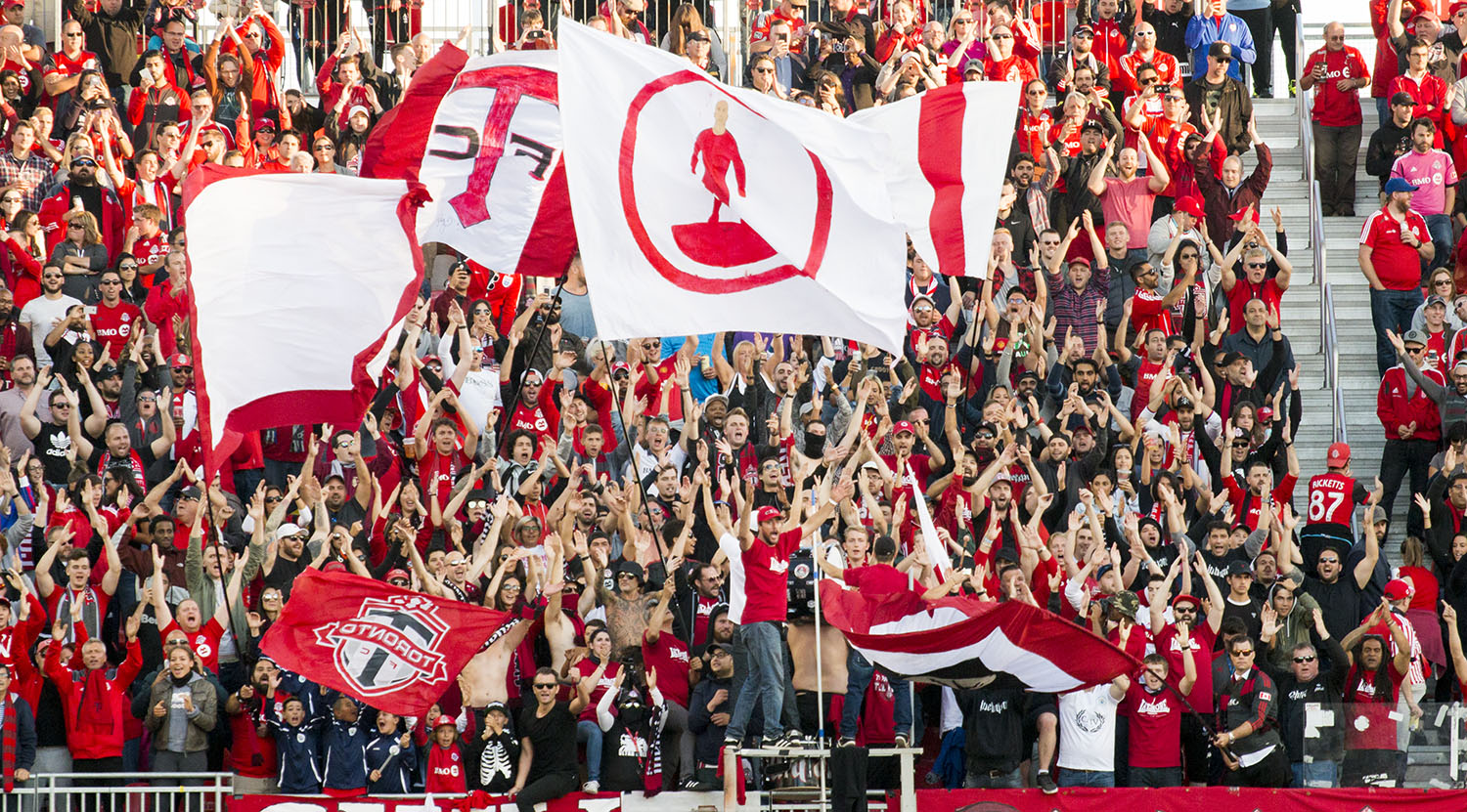 The south end supporter's section goes wild over a fourth goal at BMO Field against the San Jose Earthquakes. Image by Dennis Marciniak of denMAR Media.
