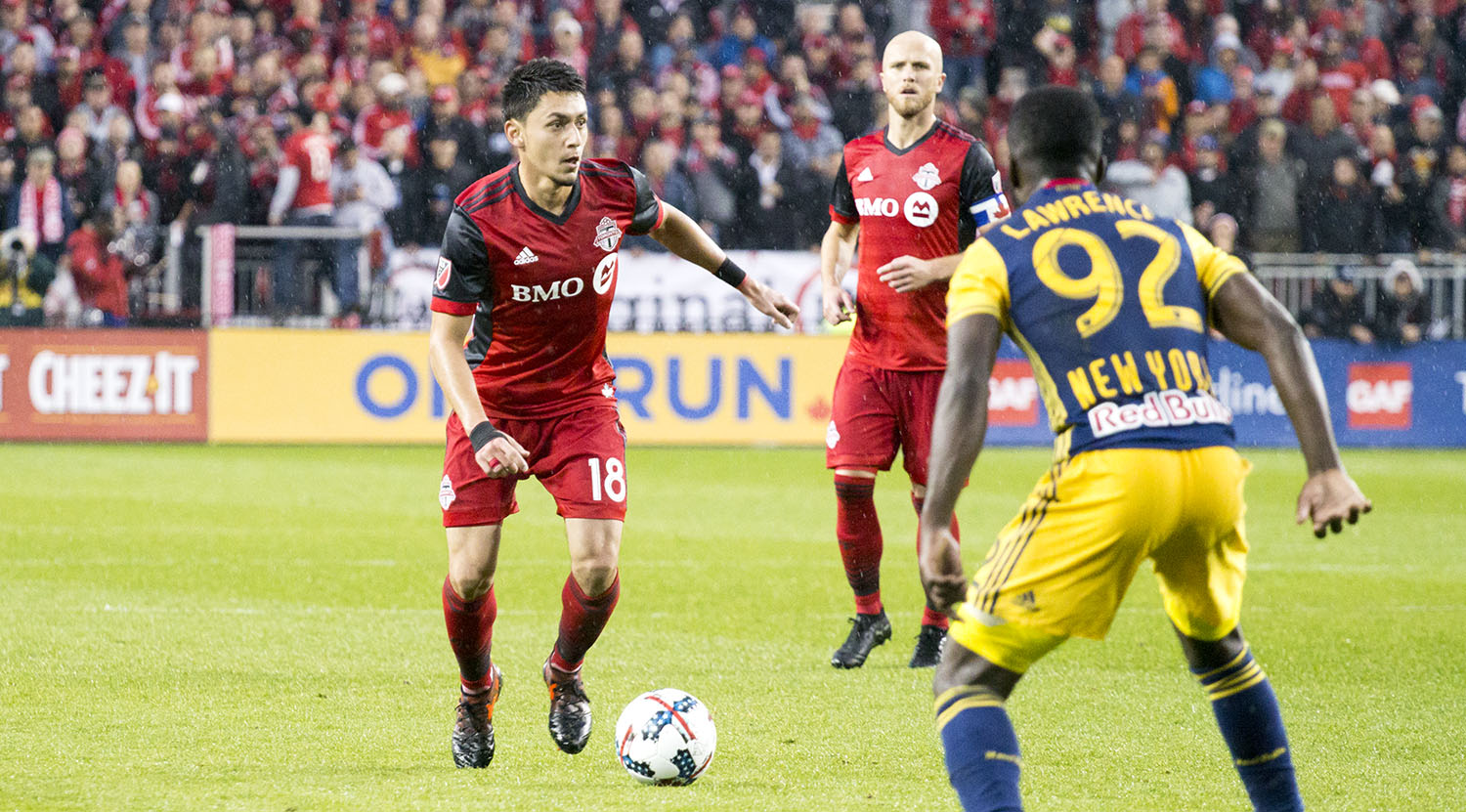 Marky Delgado on the ball in the attacking third during a Toronto FC playoff match in 2017. Image by Dennis Marciniak of denMAR Media.