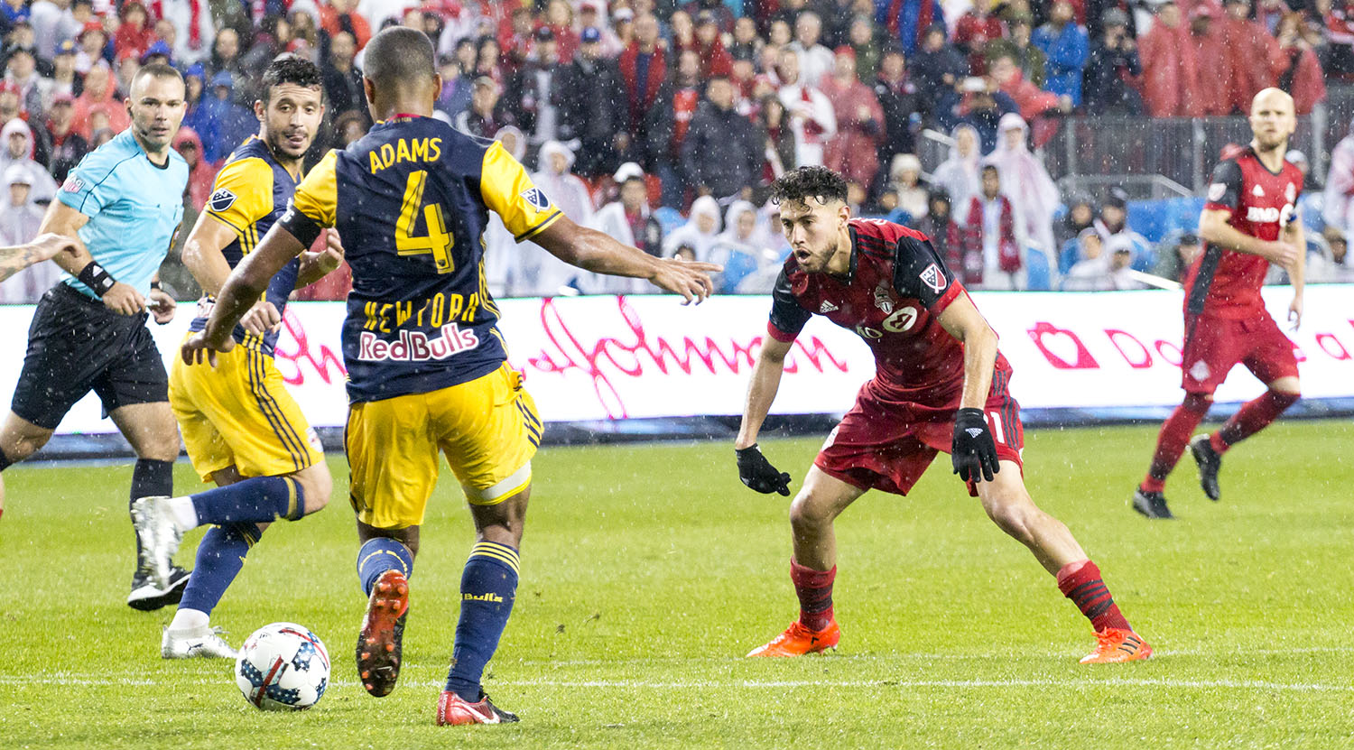 Jonathan Osorio tries to block the ball from being cleared in a Major League Soccer playoff match in 2017. Image by Dennis Marciniak of denMAR Media.