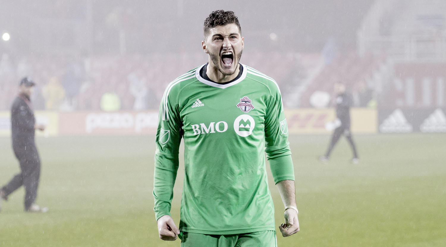 Alex Bono celebrates with the south end at BMO Field during a playoff match in 2017.