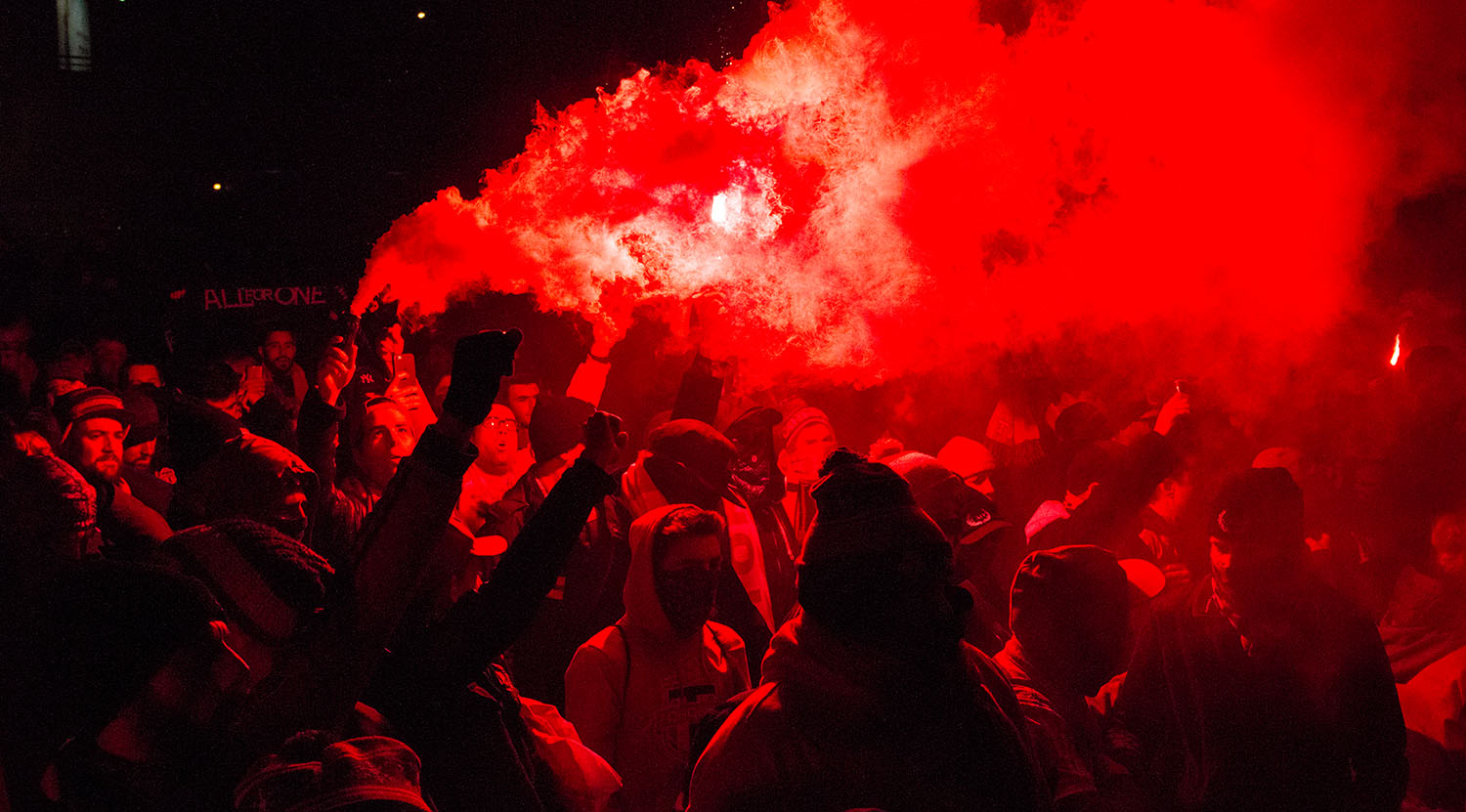 Toronto FC supporters lighting flares and smoke in front of BMO Field during that march to the match ahead of the Major League Soccer Eastern Conference Final.Image by Dennis Marciniak of denMAR Media.