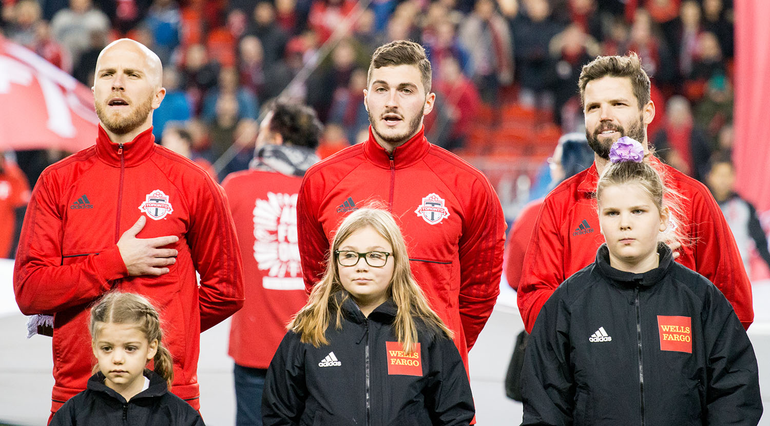 Toronto FC oberserving the national anthems just ahead of kickoff during the opening ceremonies.Image by Dennis Marciniak of denMAR Media.