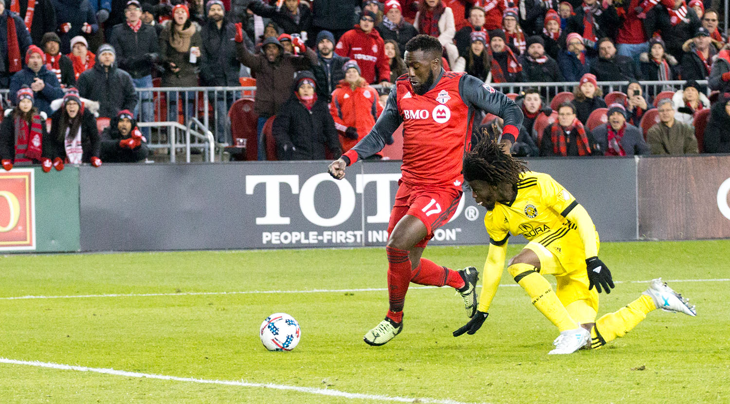 Jozy Altidore about to kick the ball into the back of the net scoring the series deciding goal at BMO Field during the 2017 Major League Soccer playoffs.Image by Dennis Marciniak of denMAR Media.
