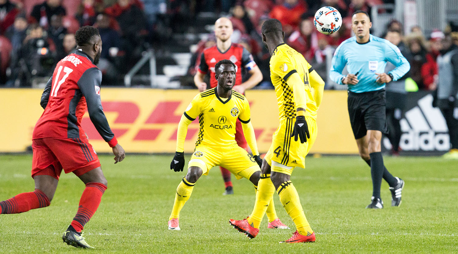 Toronto FC and Columbus crew players looking to get to the ball during a MLS playoff match in 2017.Image by Dennis Marciniak of denMAR Media.