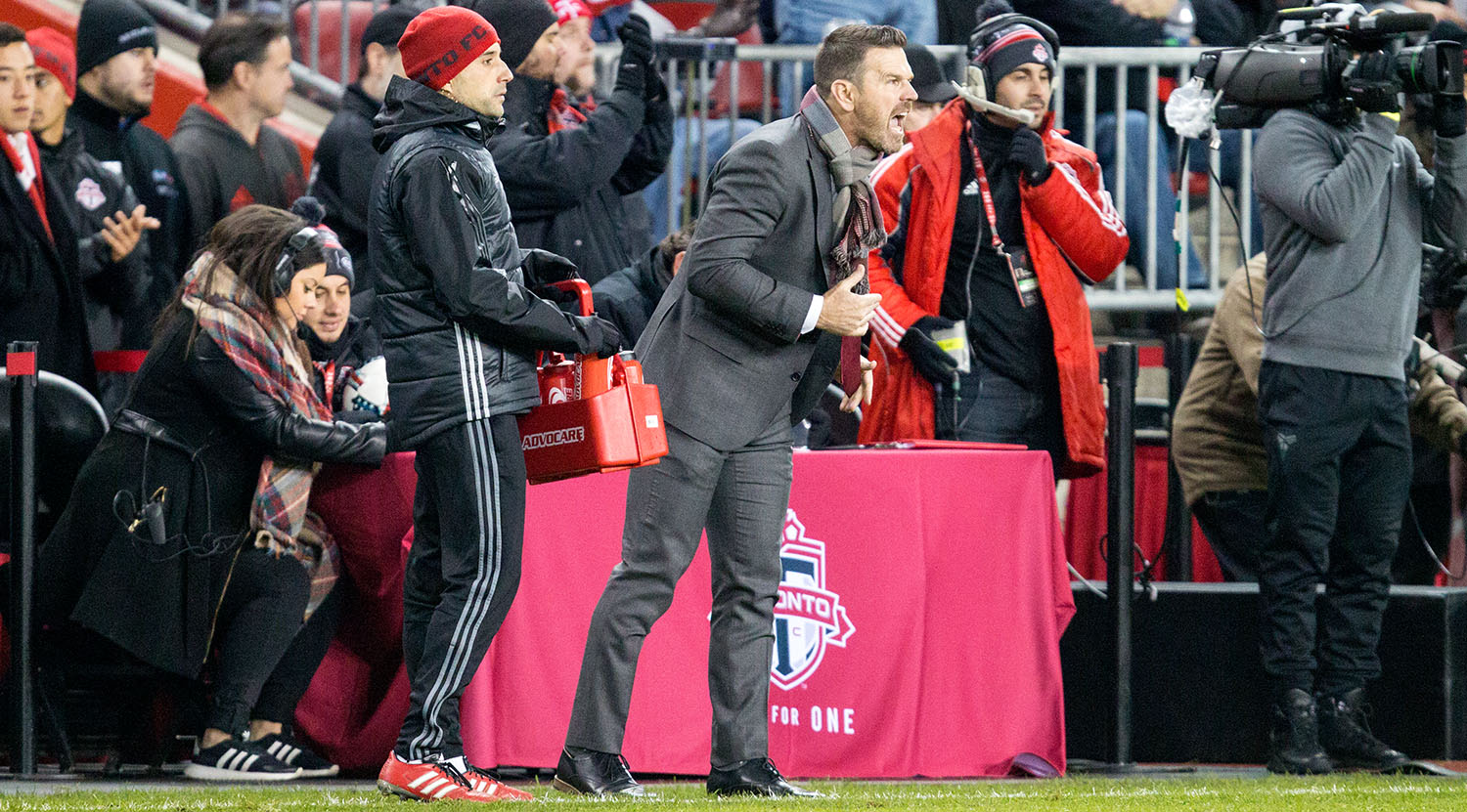 2017 Major League Soccer coach of the year Greg Vanney yelling instructions to his squad during the second half of the Eastern Conference Final at BMO Field in Toronto, Canada.Image by Dennis Marciniak of denMAR Media.
