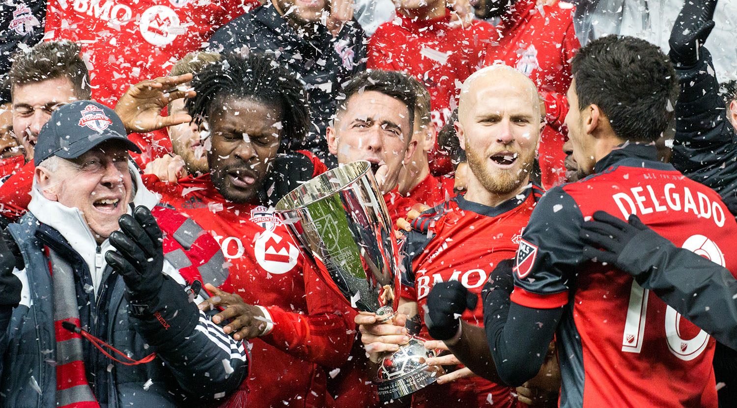 Toronto FC celebrating the advance to the 2017 Major League Soccer Finale with the Eastern Conference trophy.Image by Dennis Marciniak of denMAR Media.