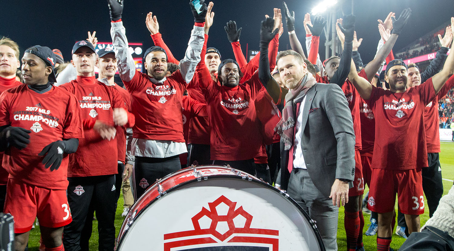 Greg Vanney at the drum celebrating the Eastern Conference final win with the south end supporters groups. Image by Dennis Marciniak of denMAR Media.