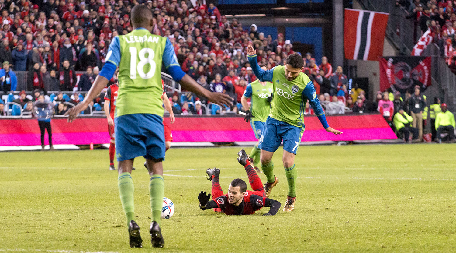 Sebastian Giovinco taken down to ground during the 2017 MLS Cup Playoffs.Image by Dennis Marciniak of denMAR Media.