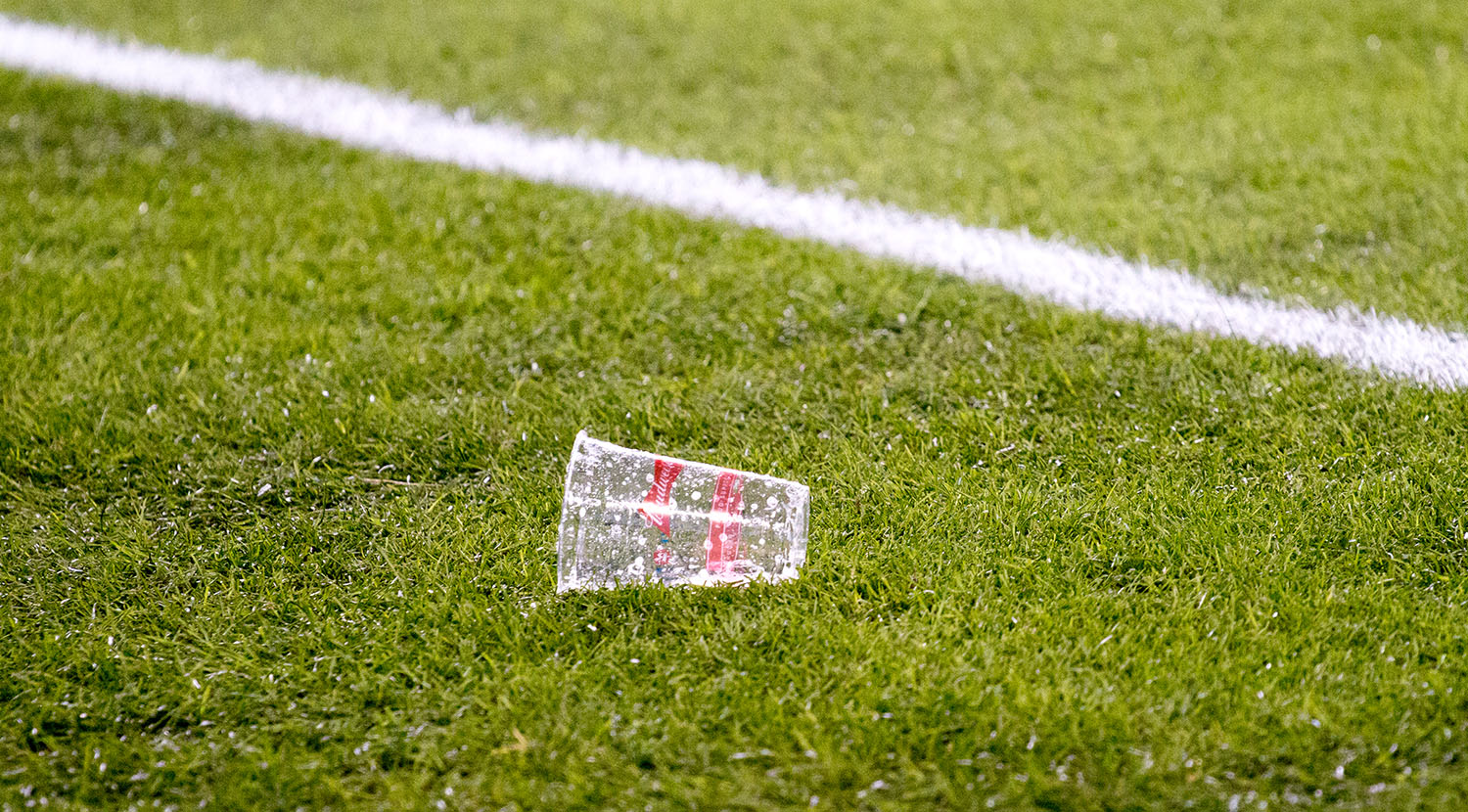 A beer thrown onto the pitch at BMO Field during the Major League Soccer Cup Final.Image by Dennis Marciniak of denMAR Media.